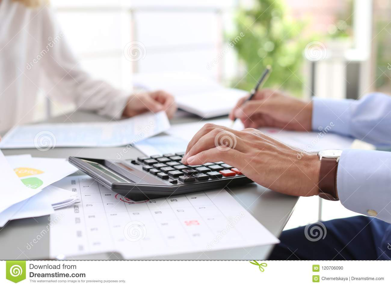 Tax accountants working with documents