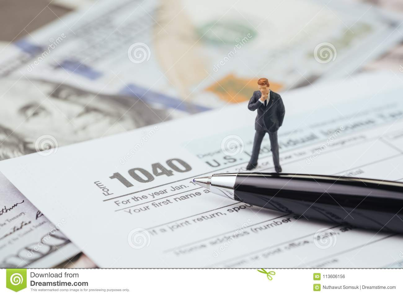 Tax Calculation Concept, Miniature Businessman Standing And