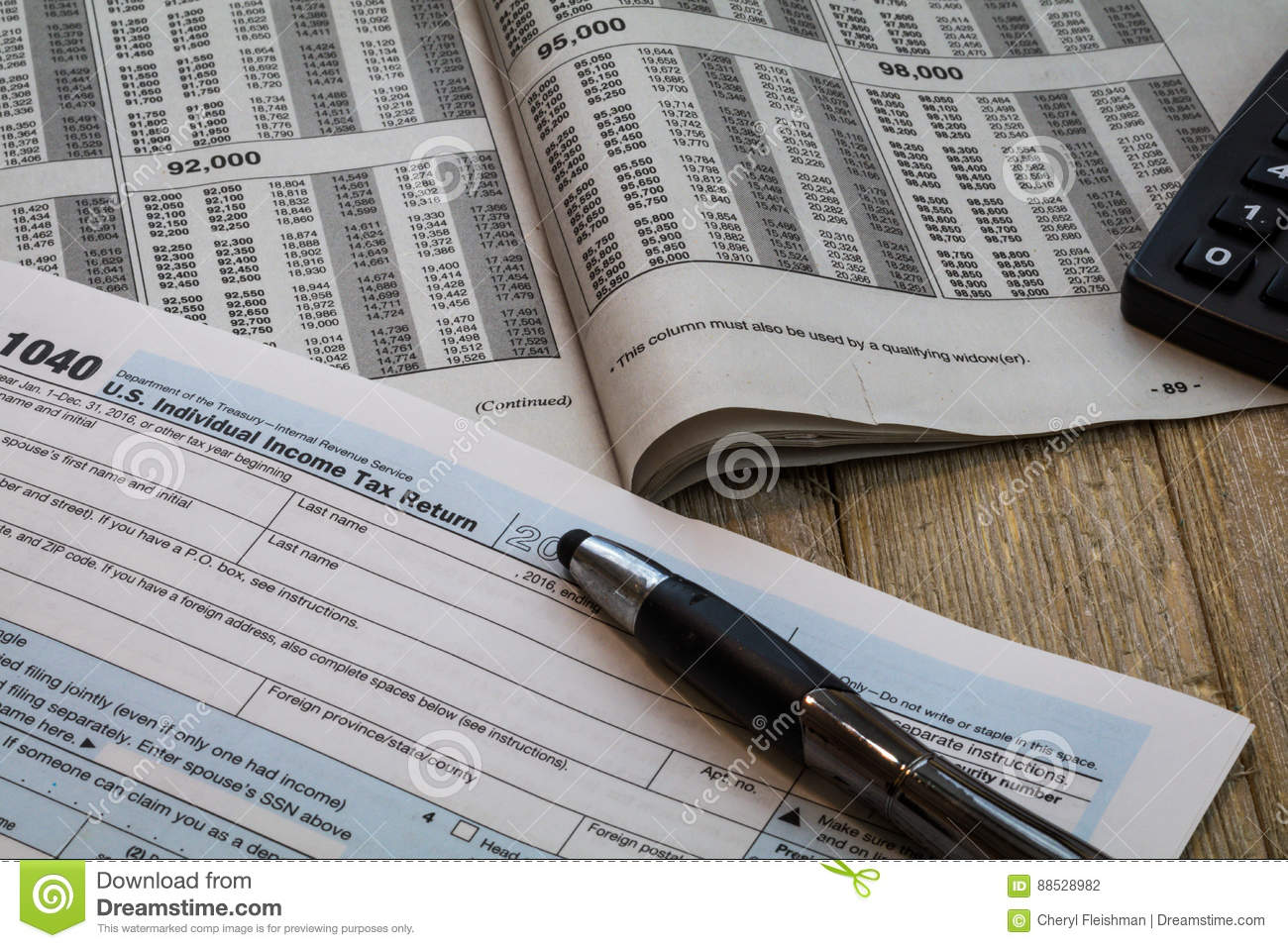 Tax Preparation Forms And Tax Table Editorial Photography