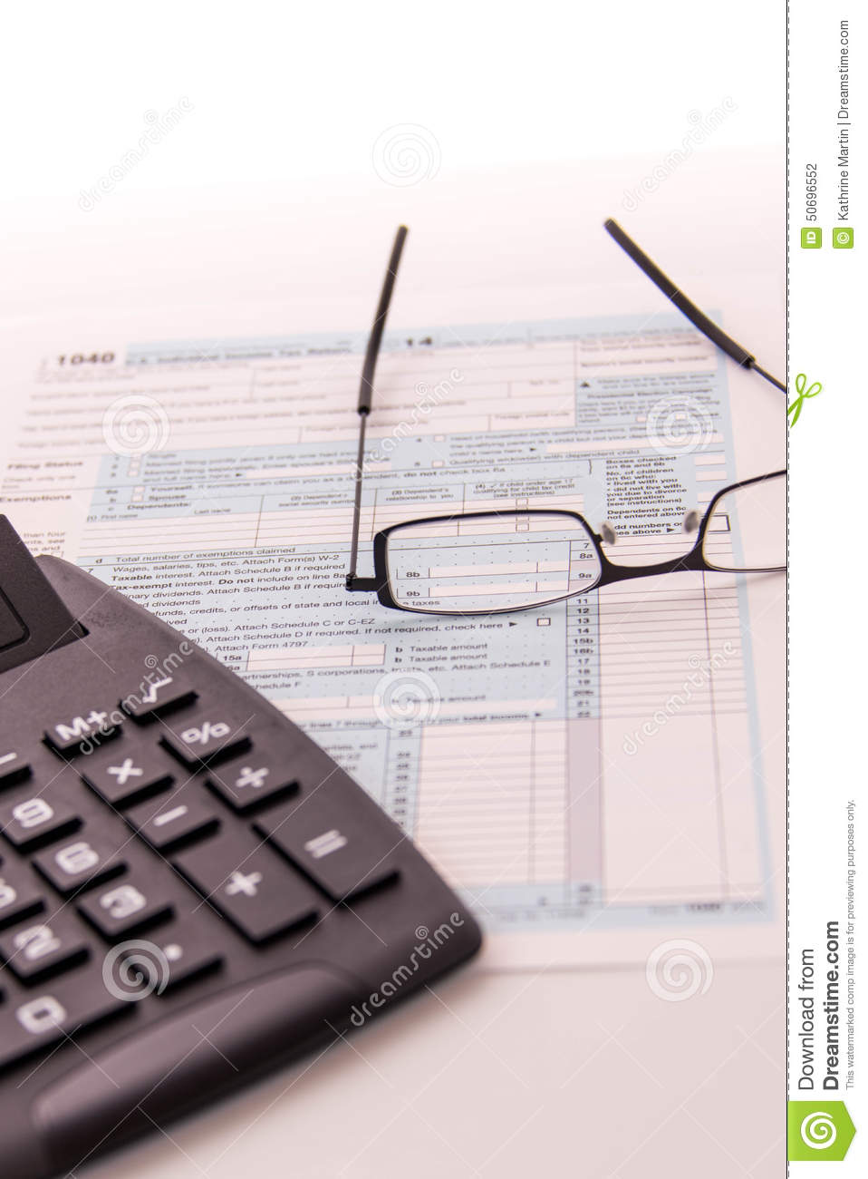 Tax preparation supplies, reading glasses and tax forms
