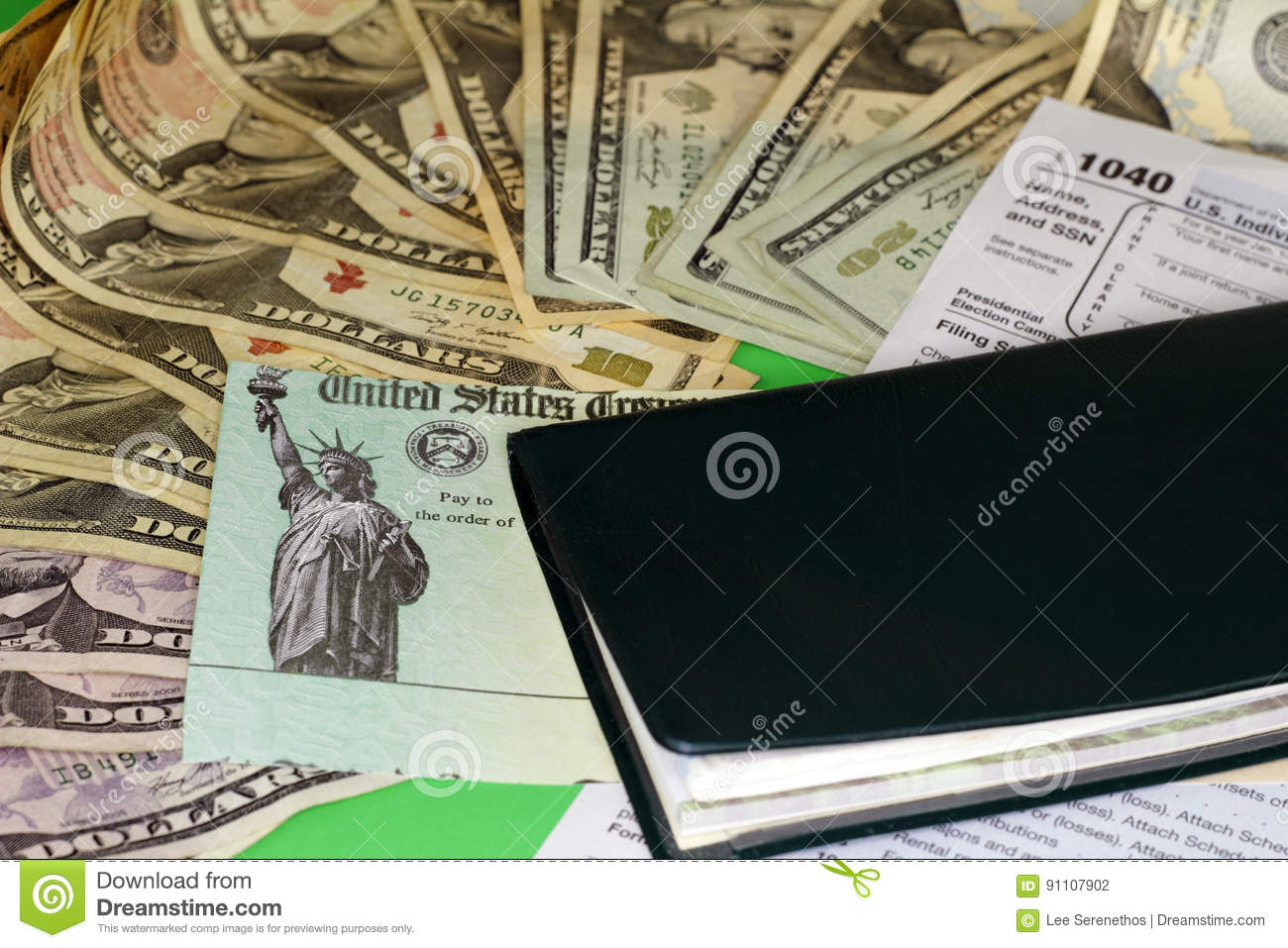 Tax Refund Check with Money and Checkbook