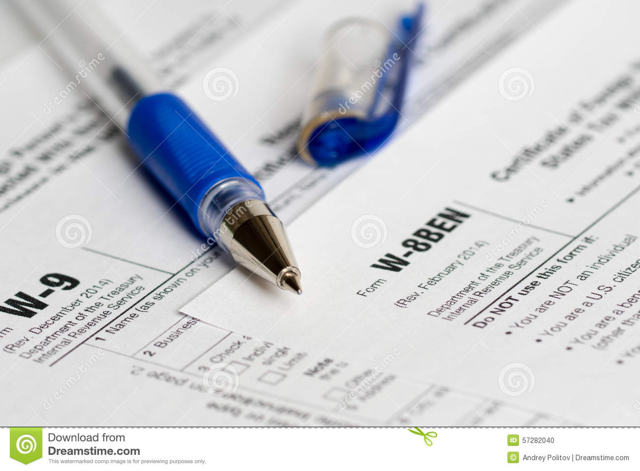 Tax reporting forms with opened blue pen