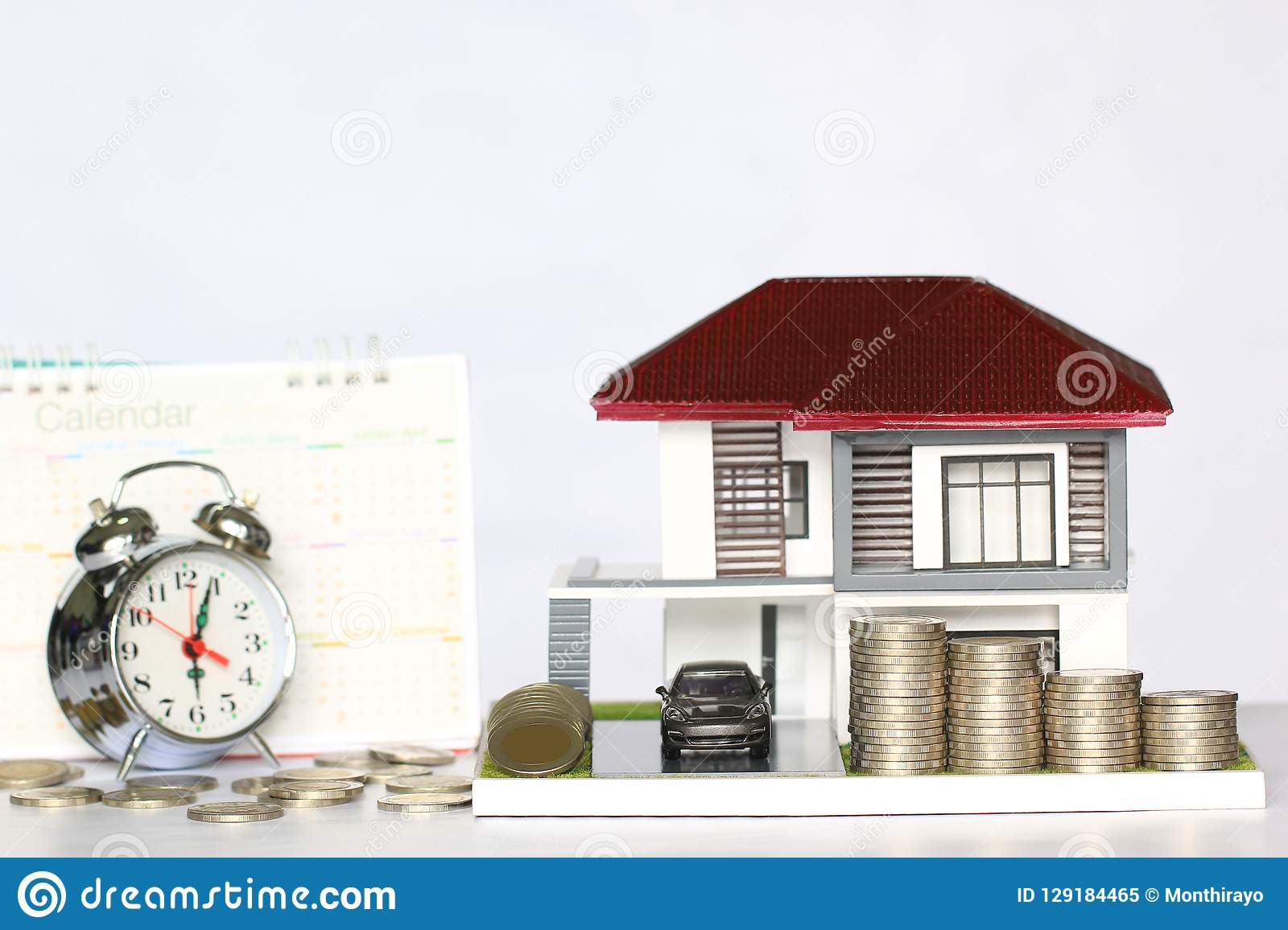 Tax time concept, Model house and car with stacking coins money