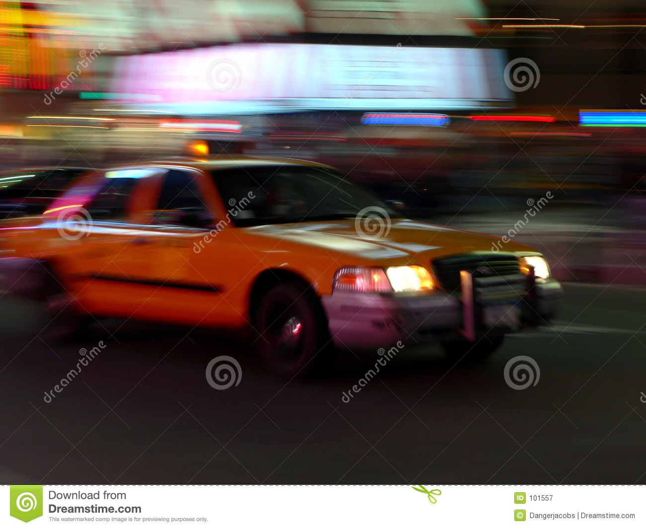 Taxi speeds down the street