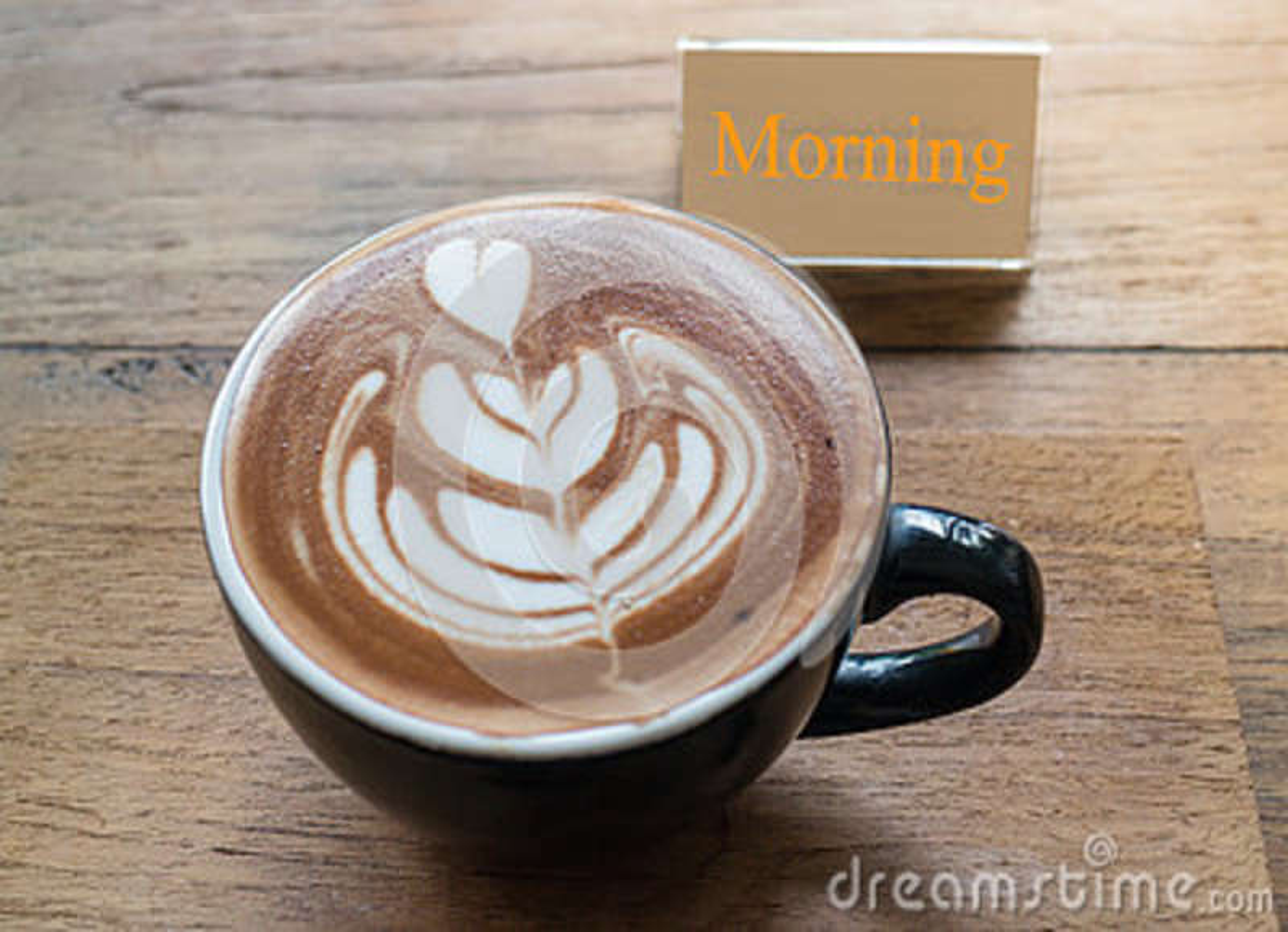Taza caliente de café del arte del latte