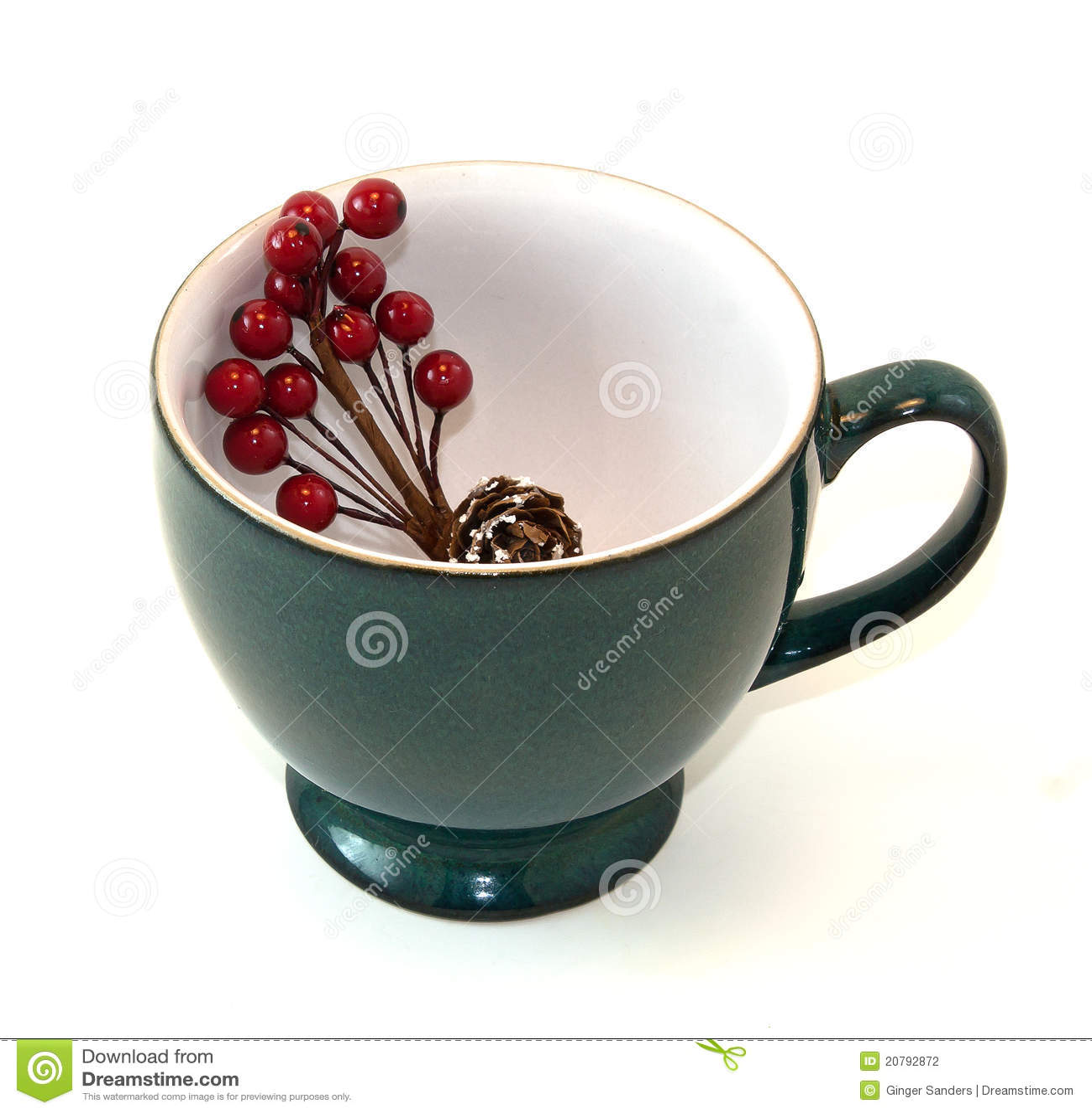 Taza de café con el aerosol floral del día de fiesta