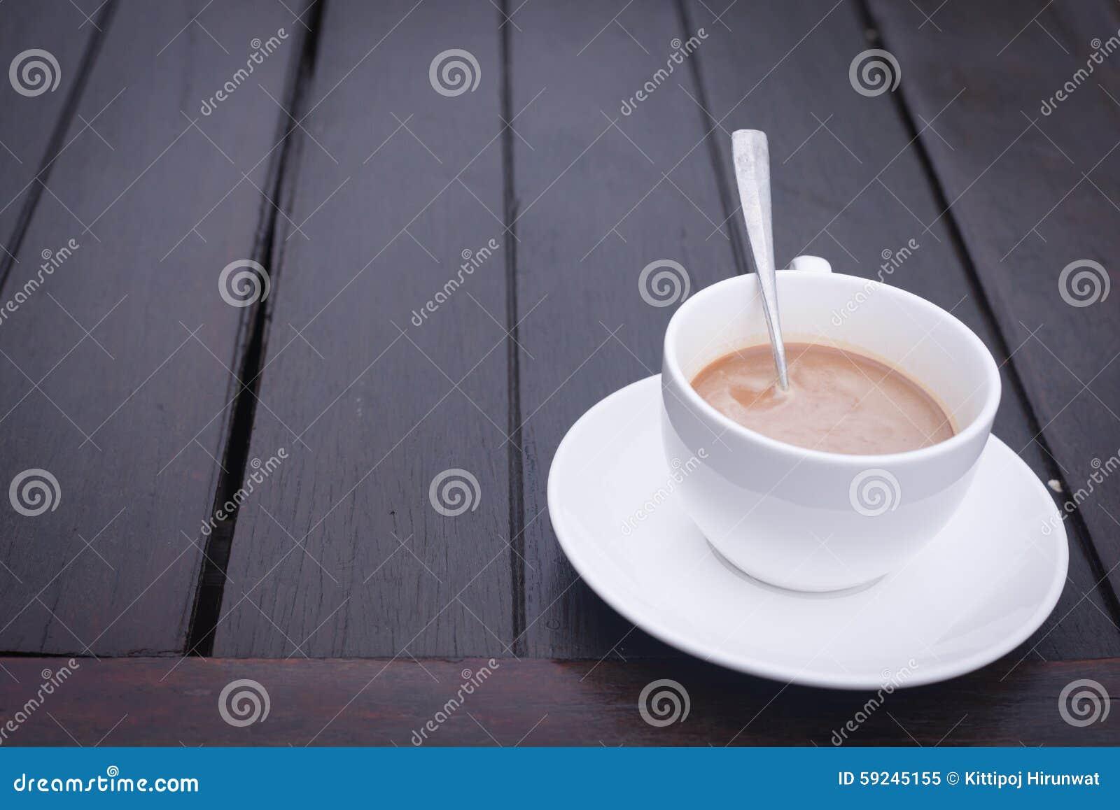 Taza de café en el vector