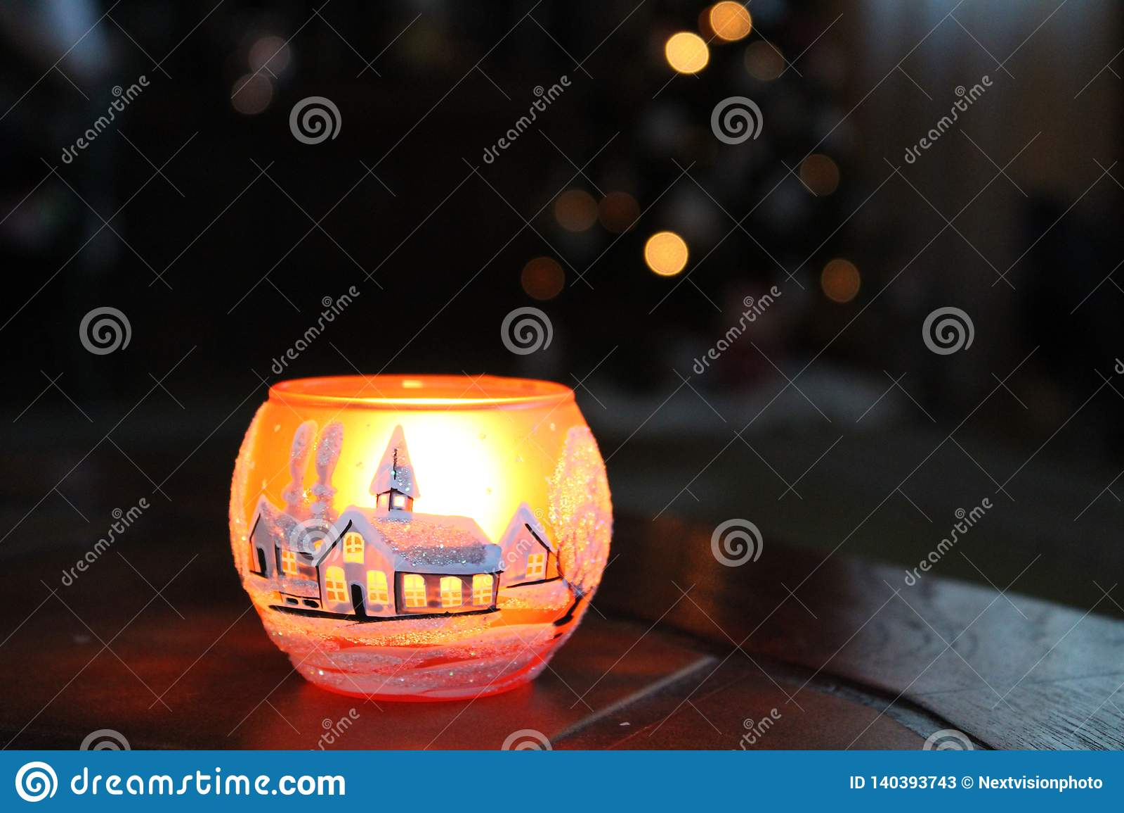 Taza de candel con la sensación de la Navidad