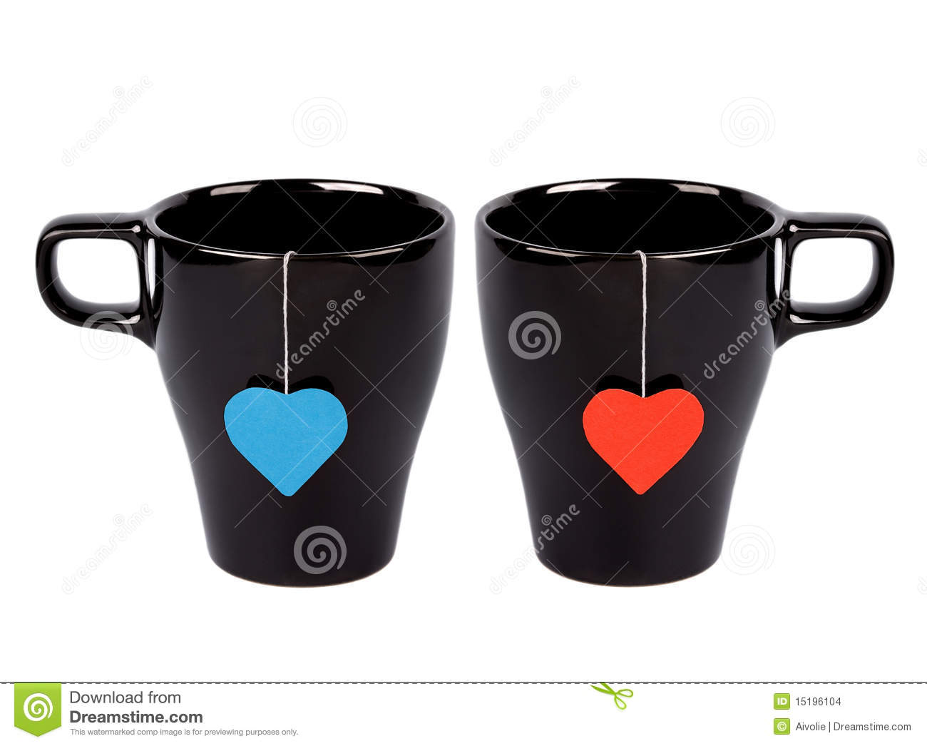 Tea bags with heart-shaped lables in cups
