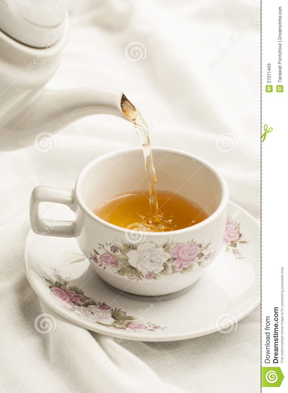 Tea Being Poured Into Tea Cup Stock Photos Image 27311493