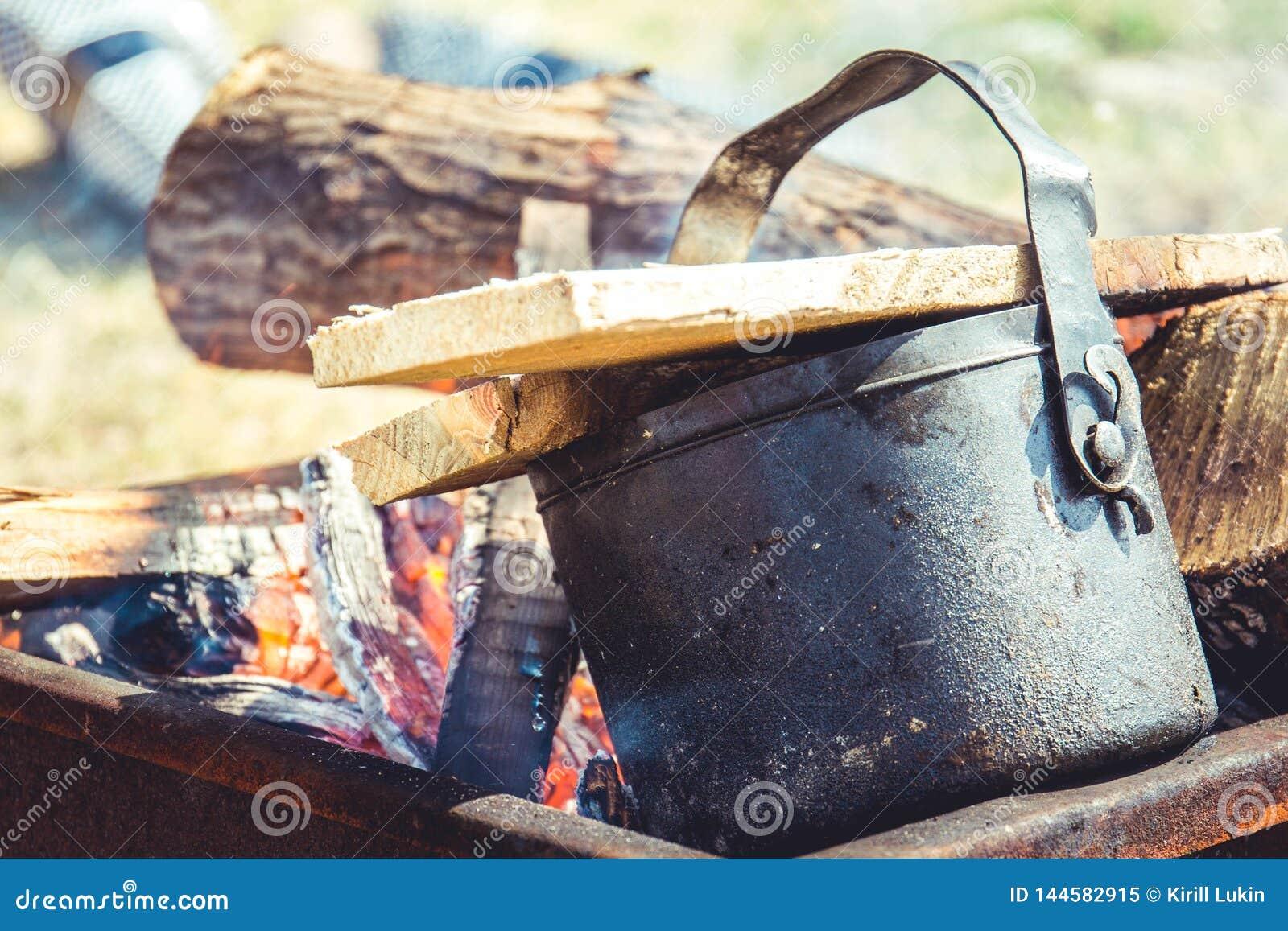 Tea brewing on a fire