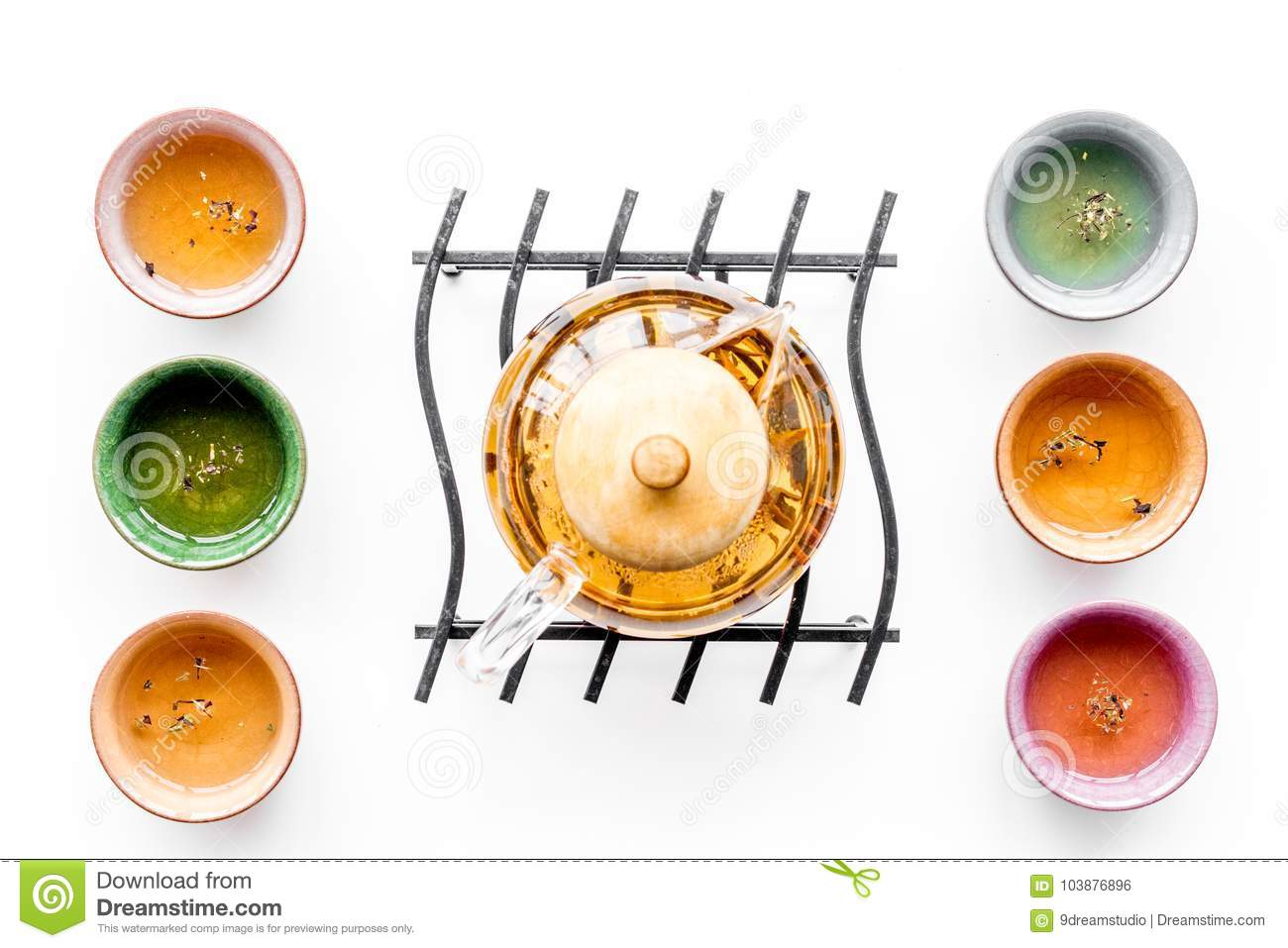 Tea ceremony concept. Tea pot, cups or bowls on white background top view pattern