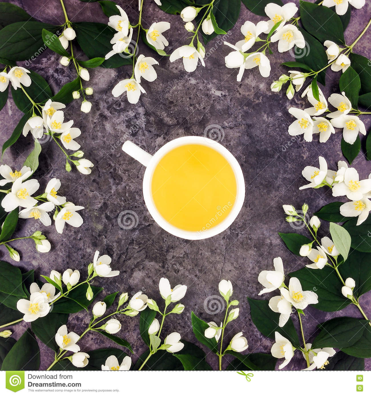 Tea cup with green tea and jasmine flowers on stone background top royalty free stock photo izmirmasajfo