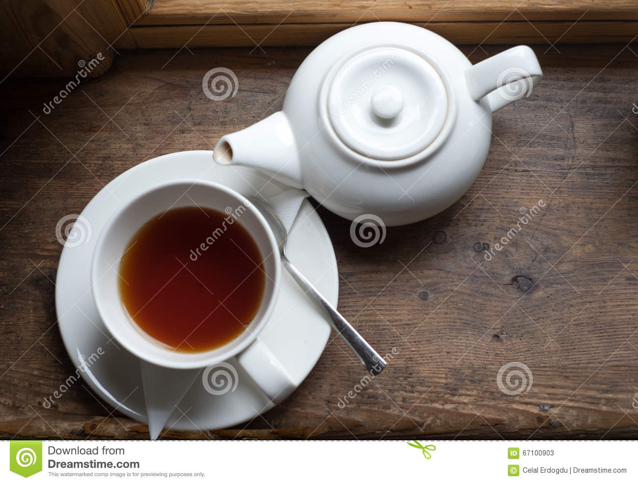 Tea cup pot and sugar on wood table