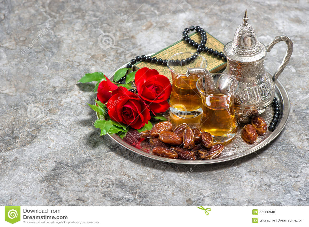 Tea, dates fruits, red rose flower, holy book quran and rosary.