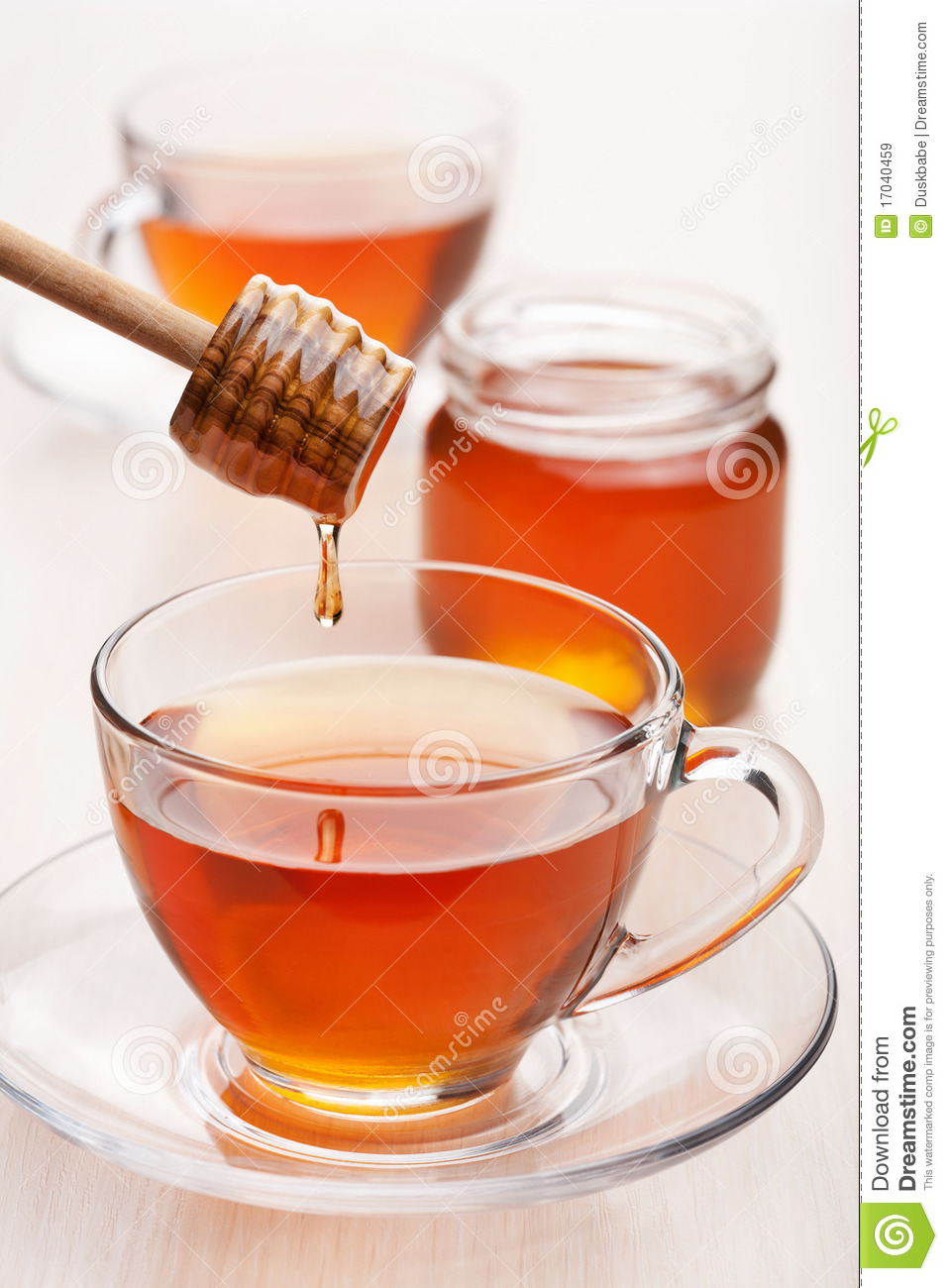 A Marble In A Cup Of Honey : Tea with honey stock image of herb closeup golden
