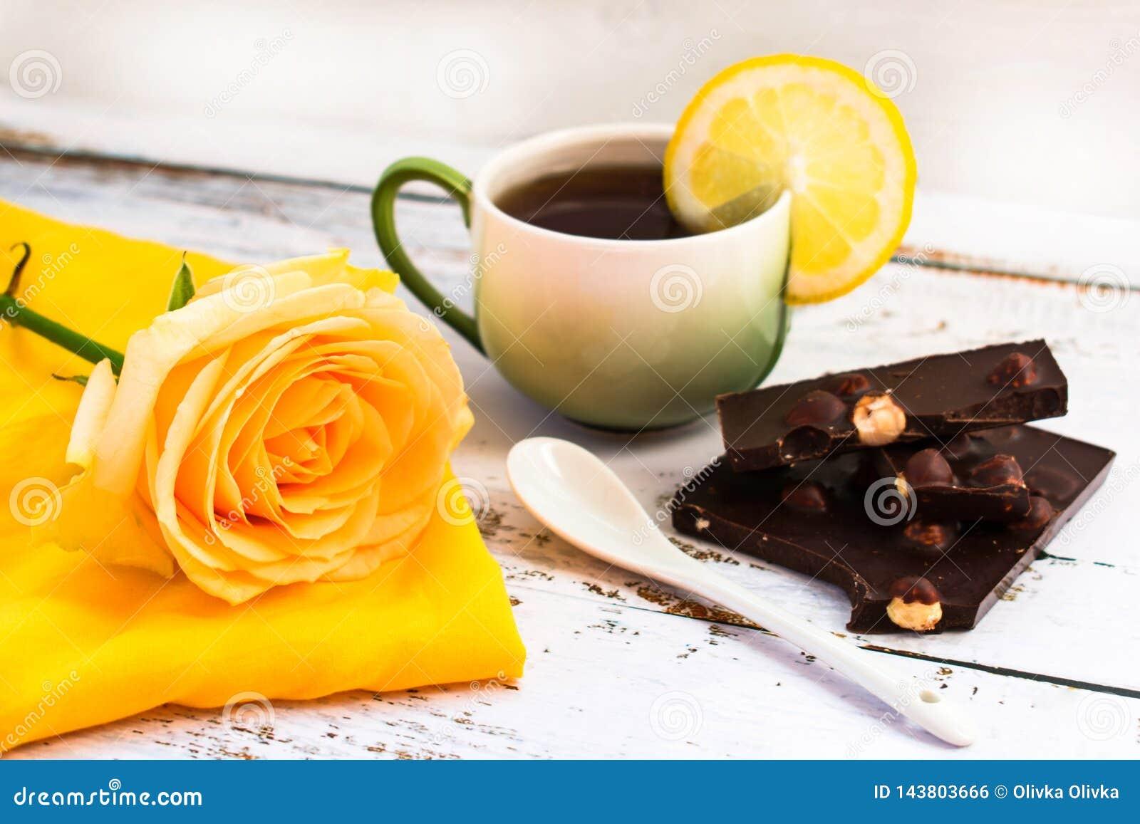 Tea with lemon, rose and black chocolate