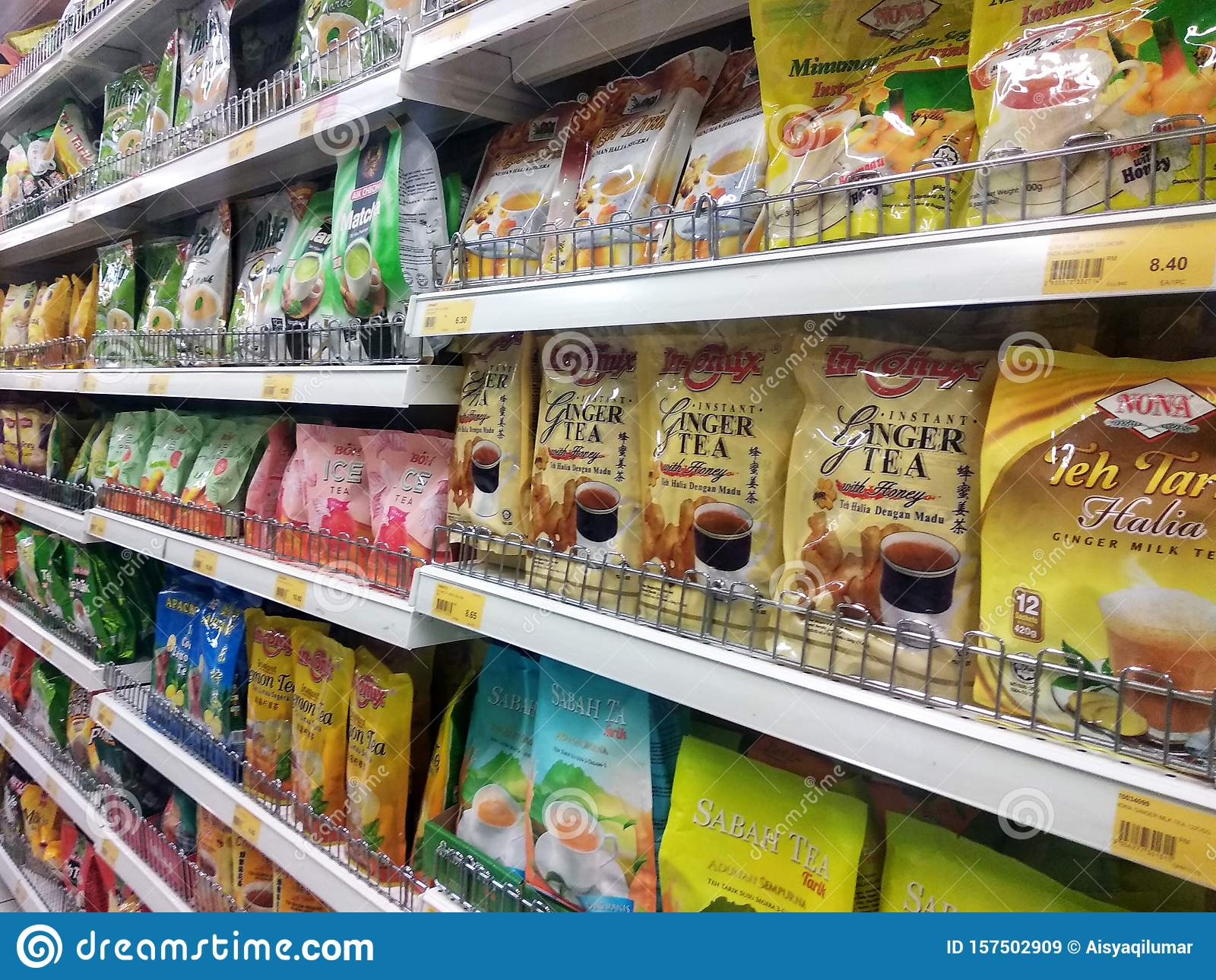 Tea powder is sold in commercial packages and displayed on supermarket shelves for sale.