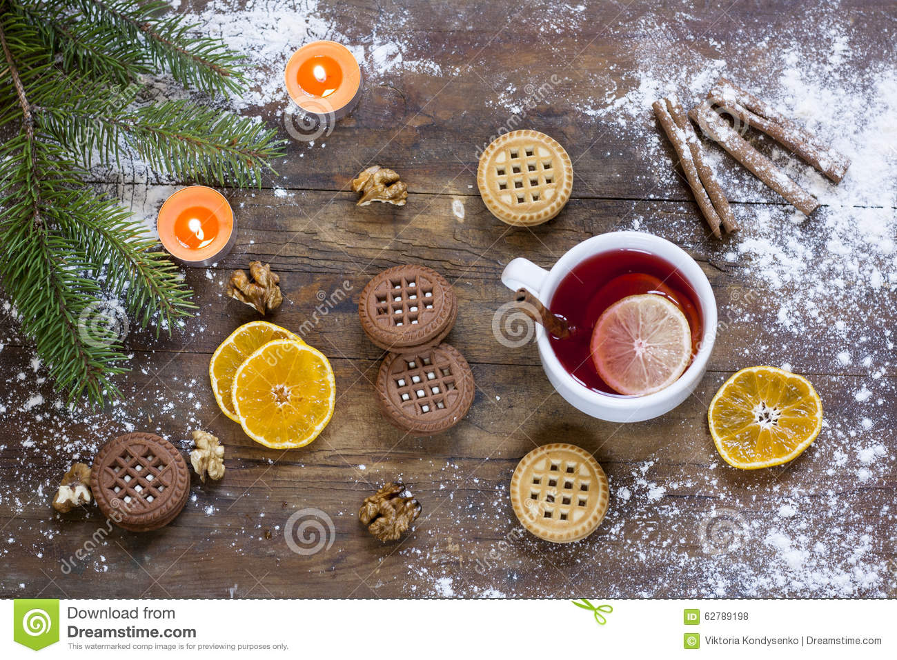 Tea tangerines and cookies in christmas decor with