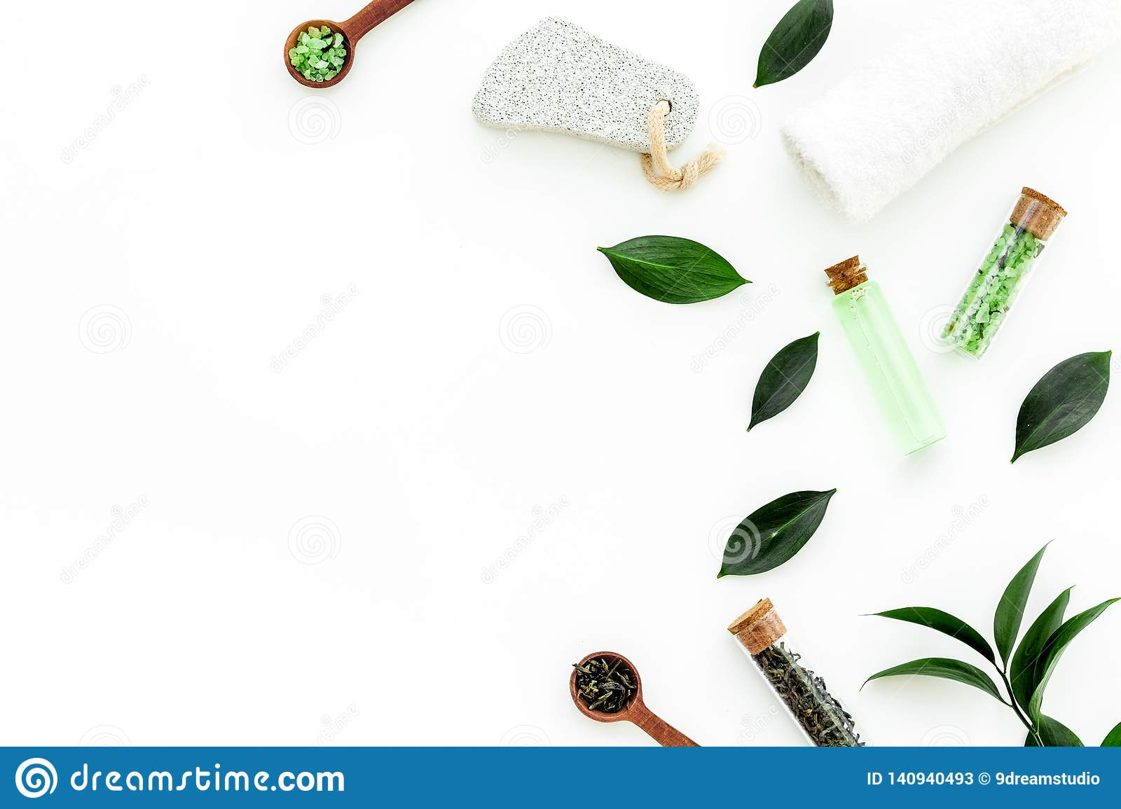 Tea tree spa composition. Fresh tea tree leaves, natural cosmetics, towel on white background top view space for text
