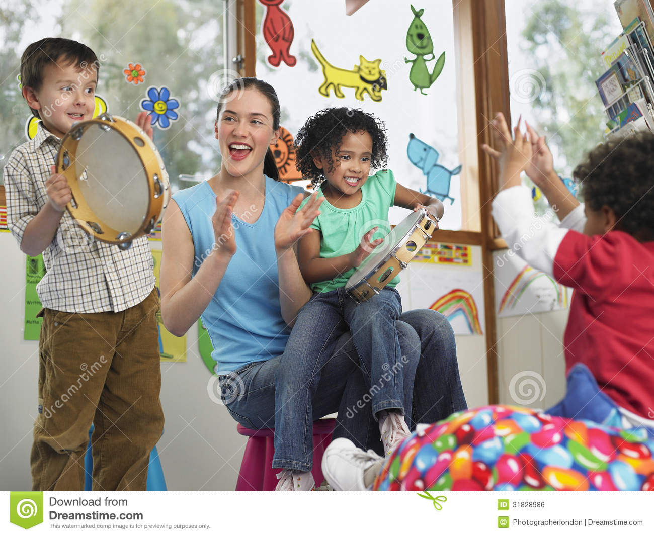 Teacher With Children Playing Music In Class