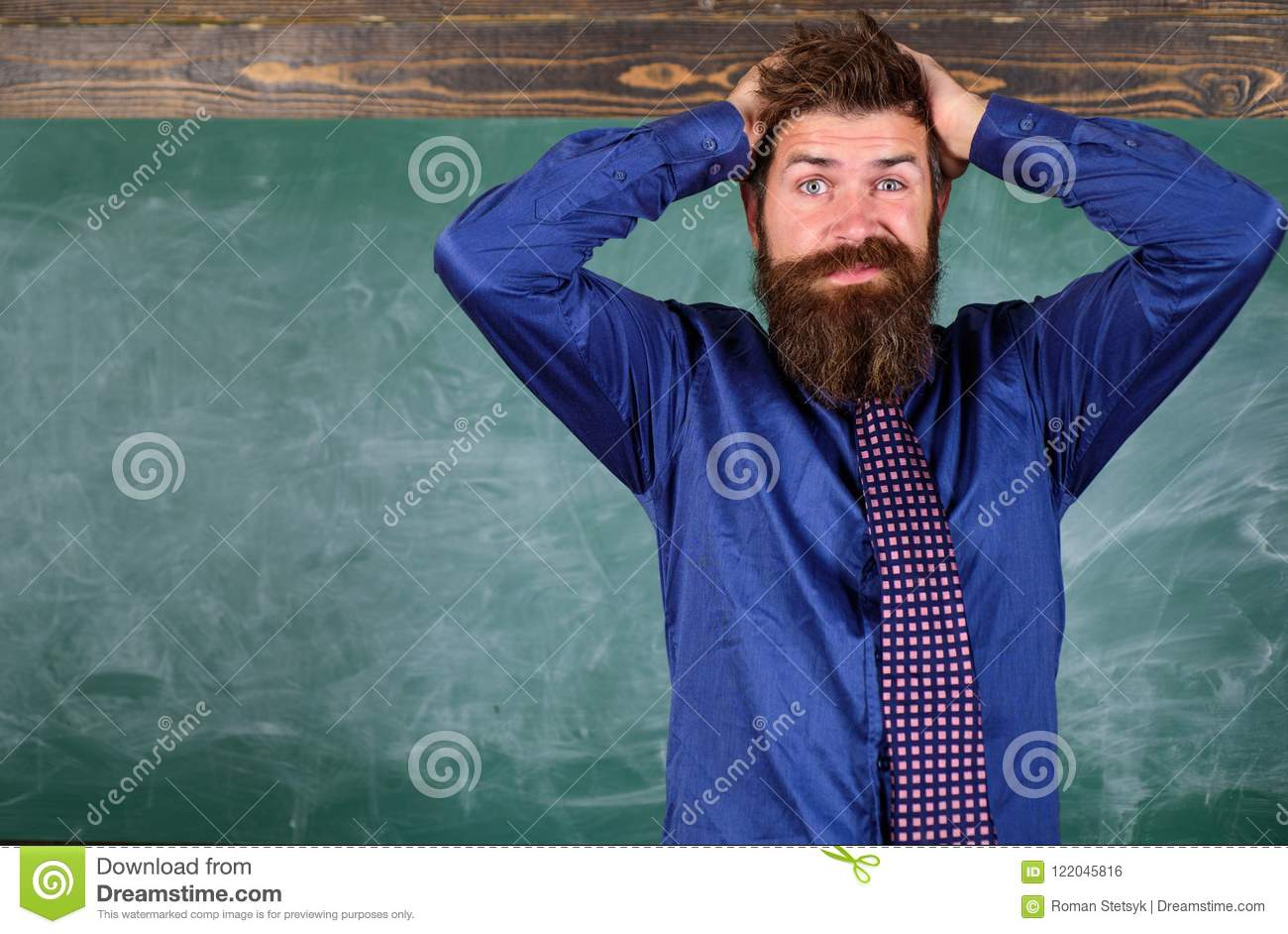 Teacher etiquette tips modern education professional. Man bearded teacher or educator hold head chalkboard background