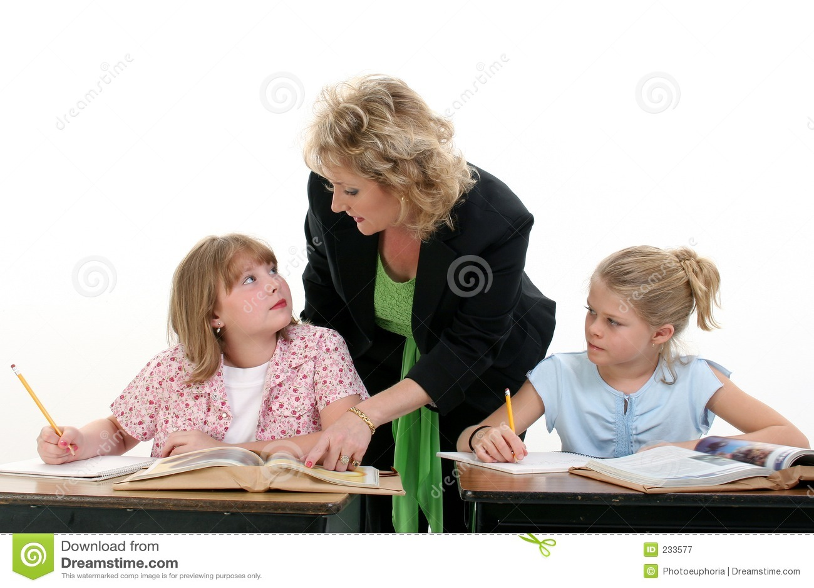 Teacher Helping Child in Classroom