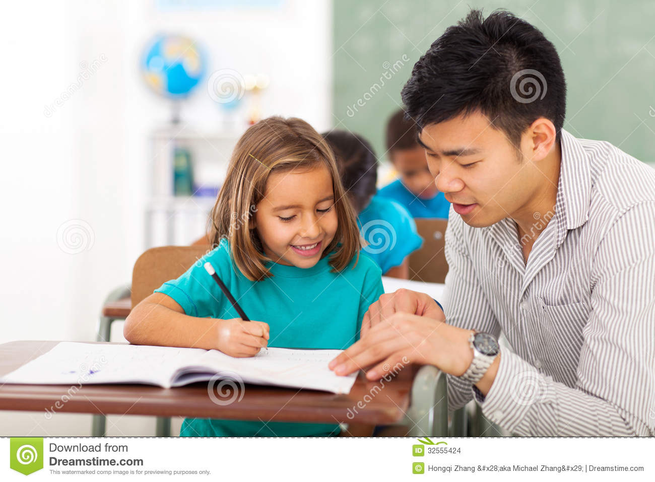 teacher helping girl stock images image 32555424