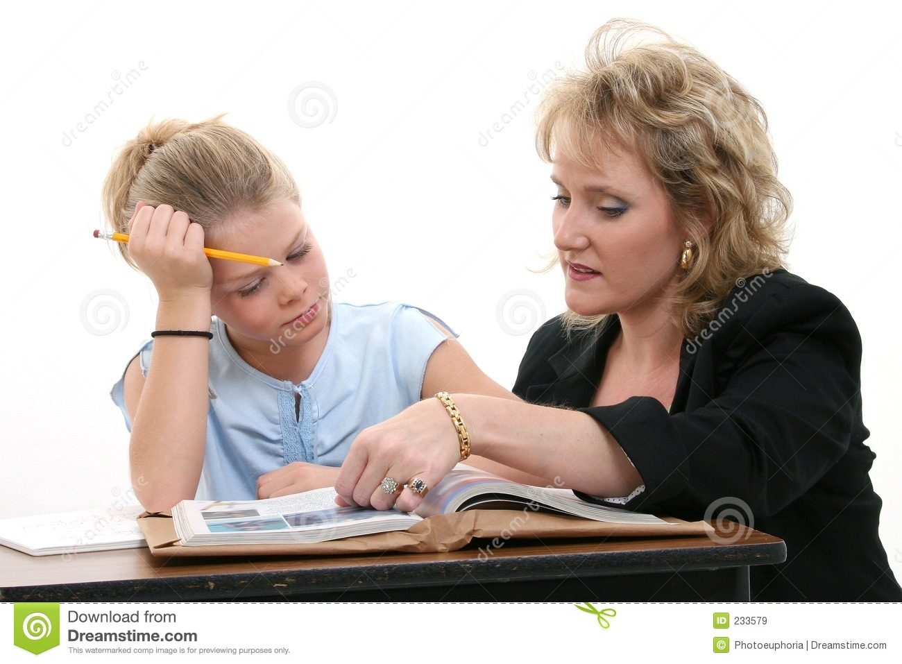 Teacher Helping Student At Desk Royalty Free Stock Images - Image ...