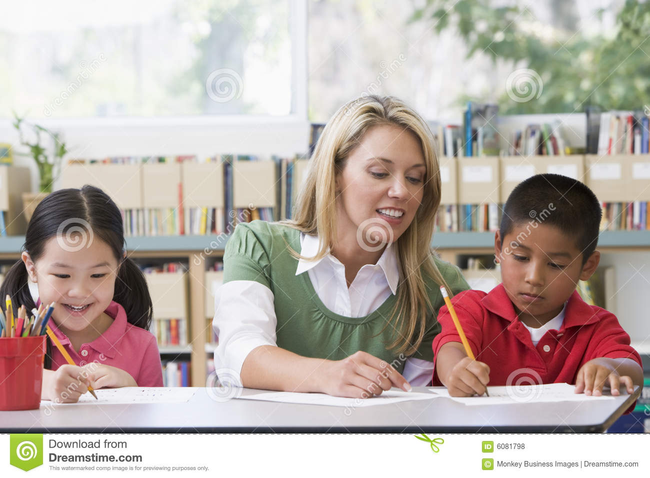 Teacher helping students with writing skills