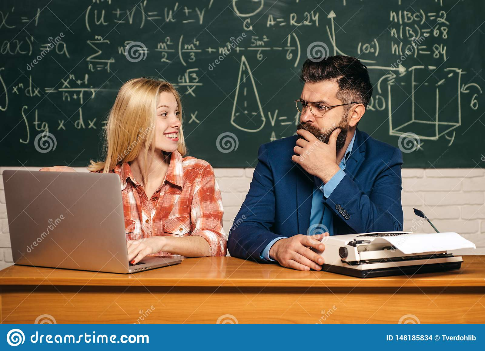 Teacher Helping Young Student With Lesson Education And Learning