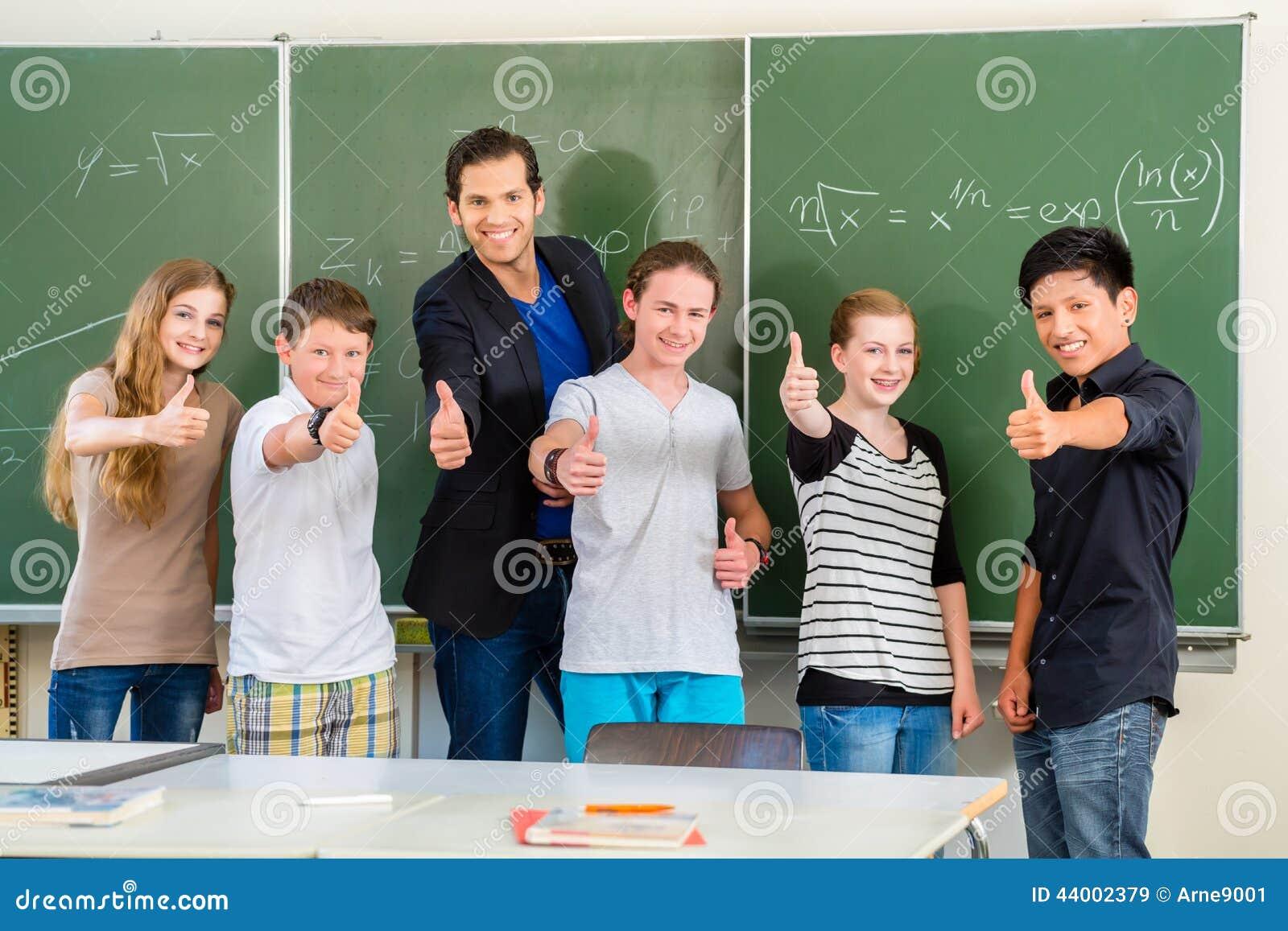 Teacher motivating students in school class