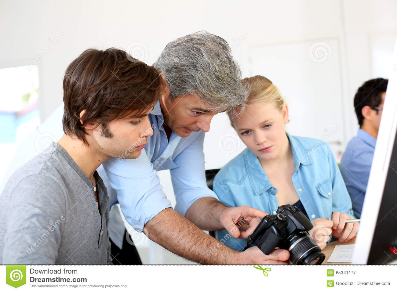Teacher In Photography Class Showing Camera Stock Photo - Image ...