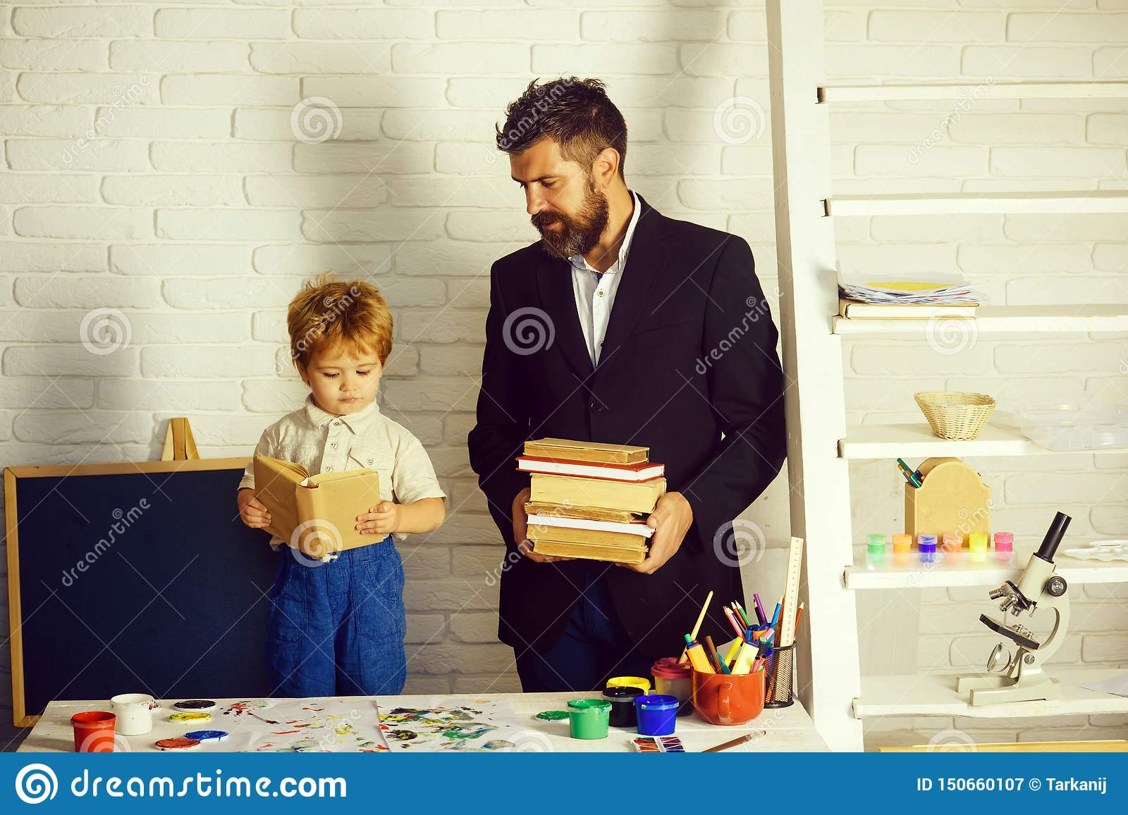 Teacher and preschooler. Books and reading. Education and tales.