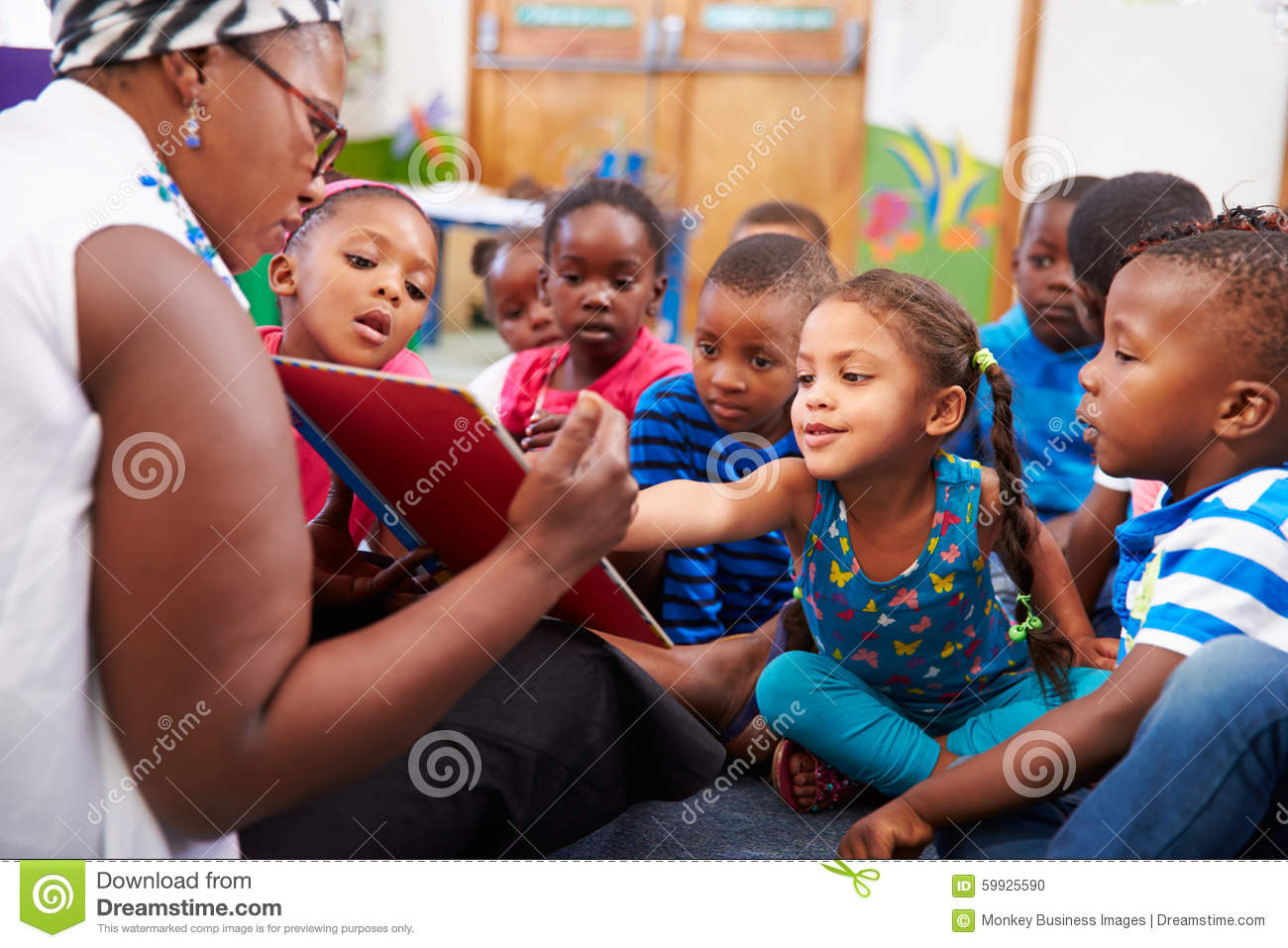teacher reading a book with a class of preschool children stock photo image 59925590. Black Bedroom Furniture Sets. Home Design Ideas