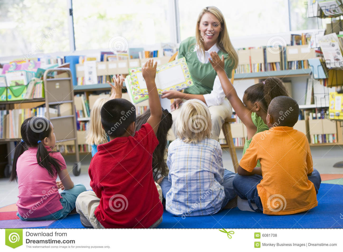 Download Teacher Reading To Children In Library Stock Photo - Image of colour, asking: 6081708
