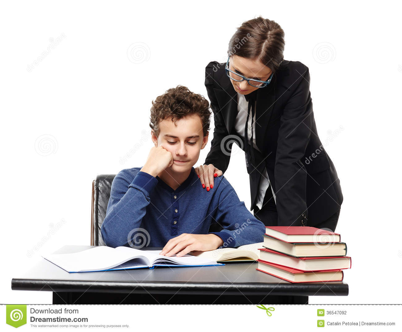 Teacher Standing Next To Student's Desk With Hand On His Shoulde Stock ...