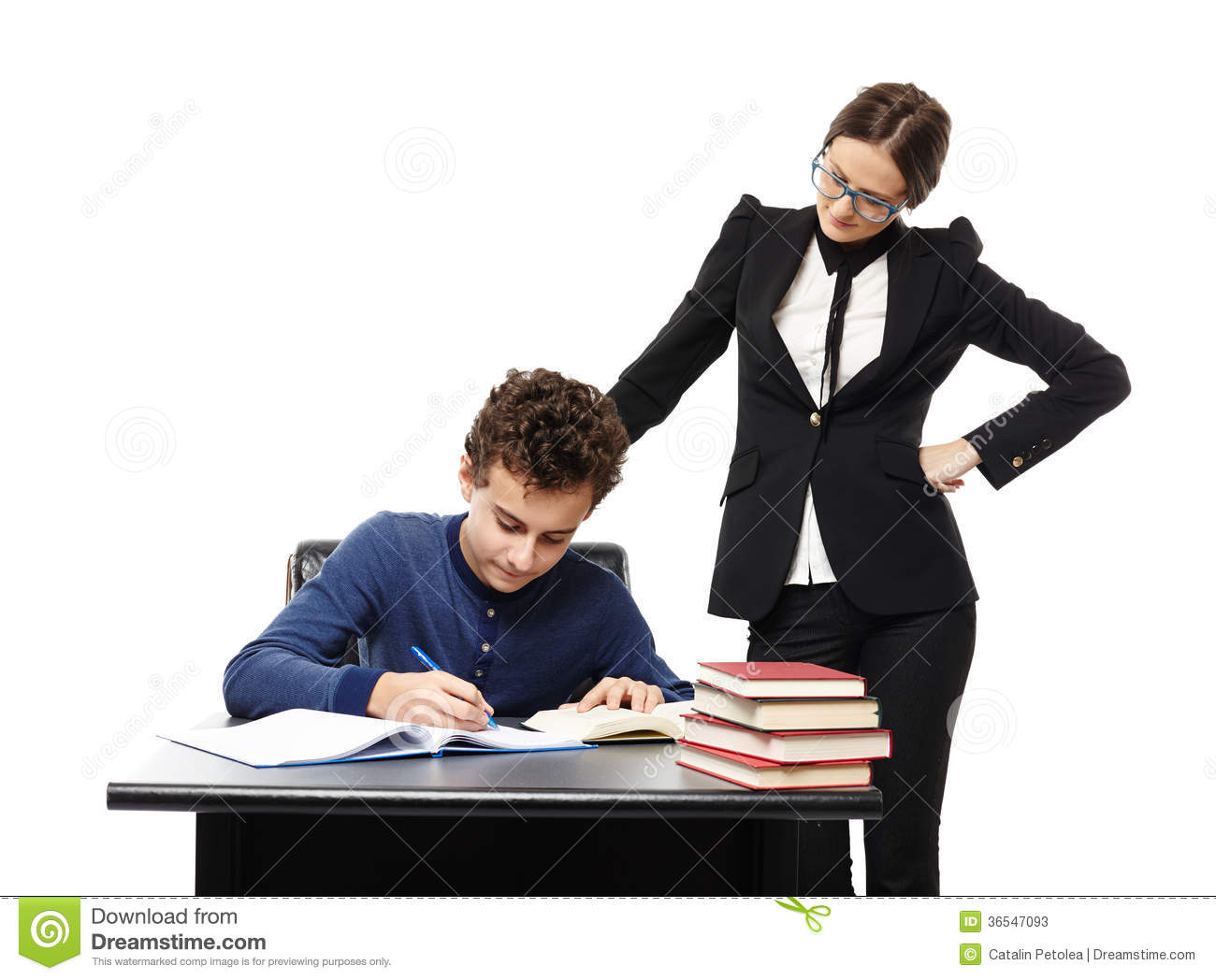 Teacher Standing Next To Student S Desk With Hand On Waist Supe