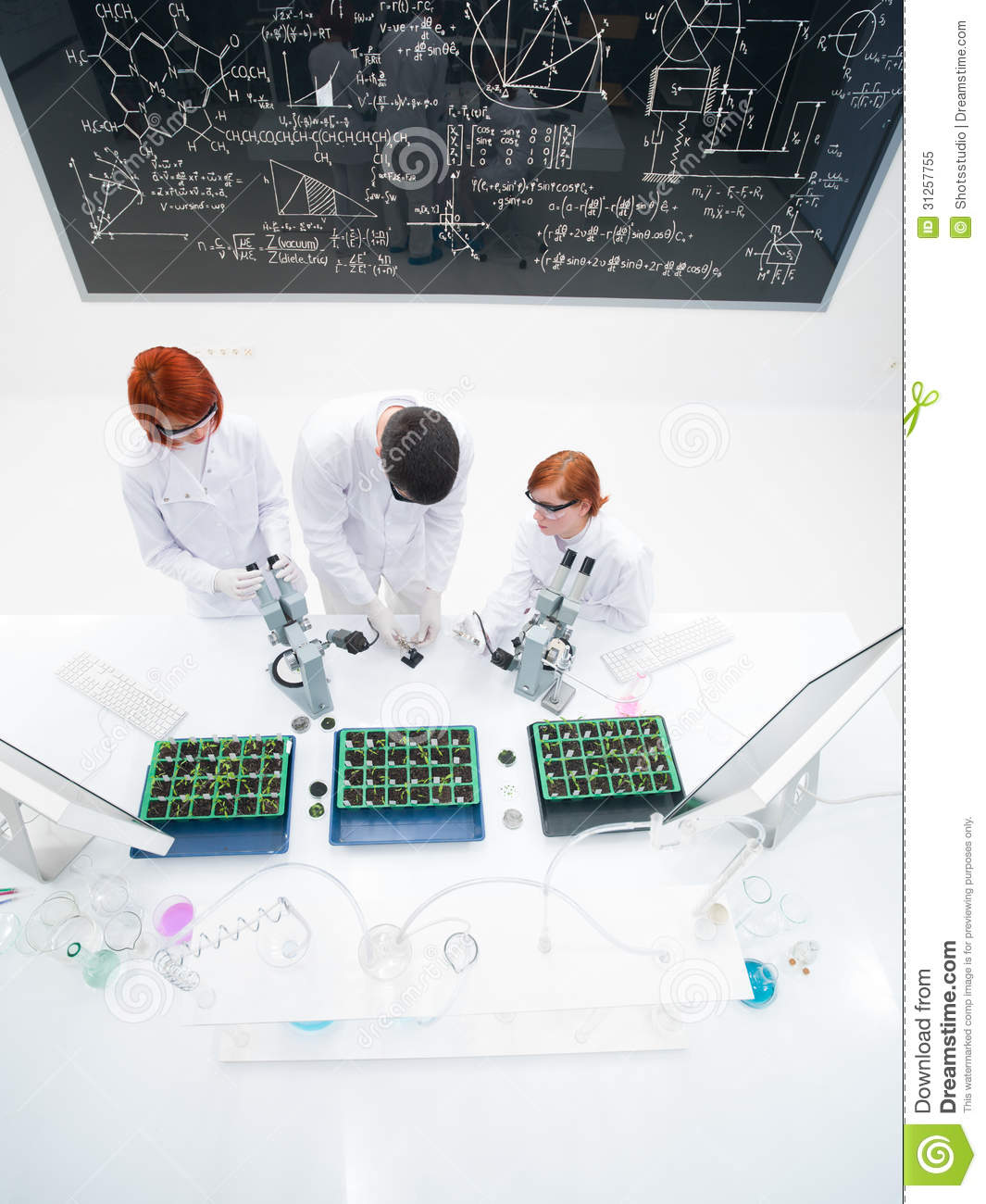 Teacher and students in laboratory
