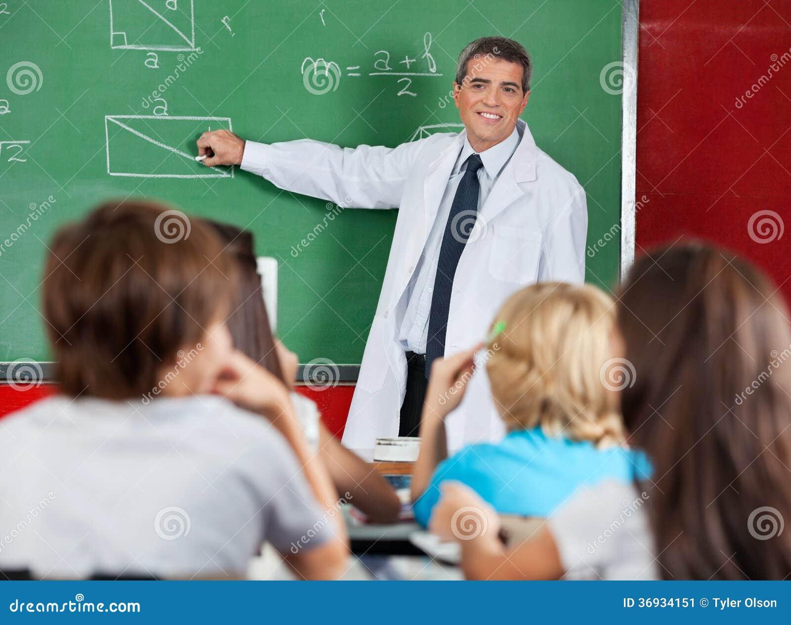 Teacher Teaching Geometry To Schoolchildren Stock Image - Image ...