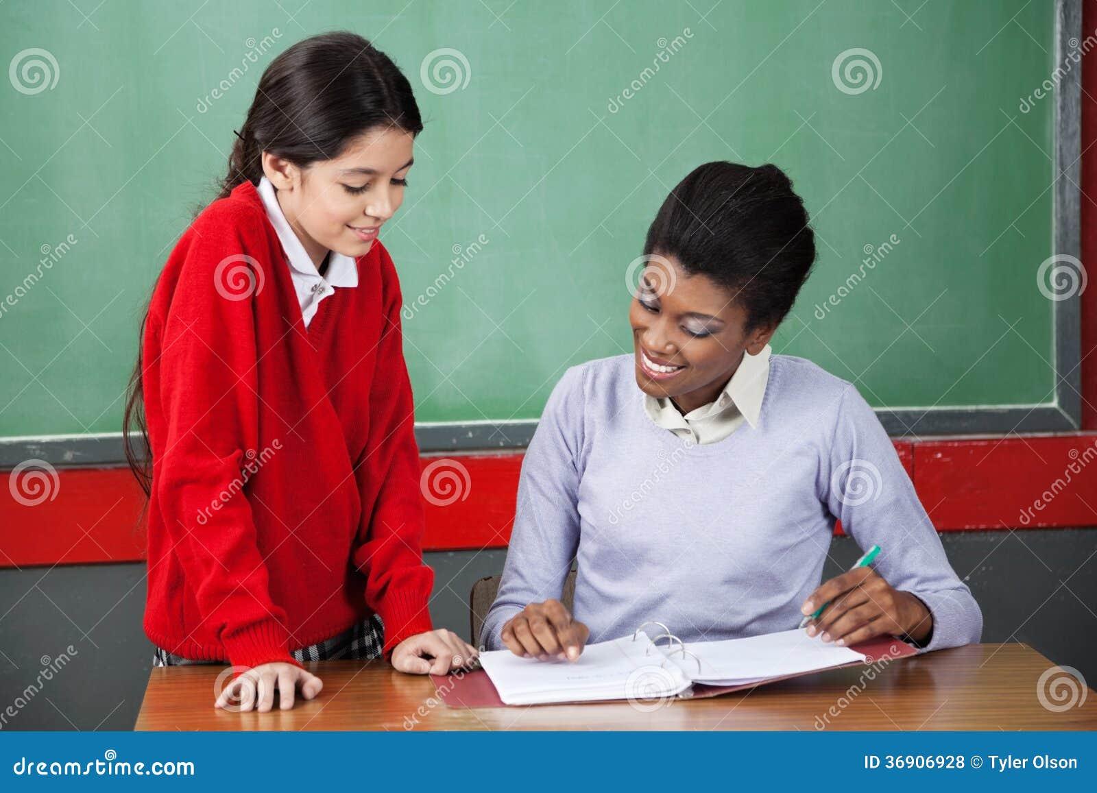 Download Teacher Teaching Schoolgirl At Desk Stock Photo Image Of Primary Desk 36906928