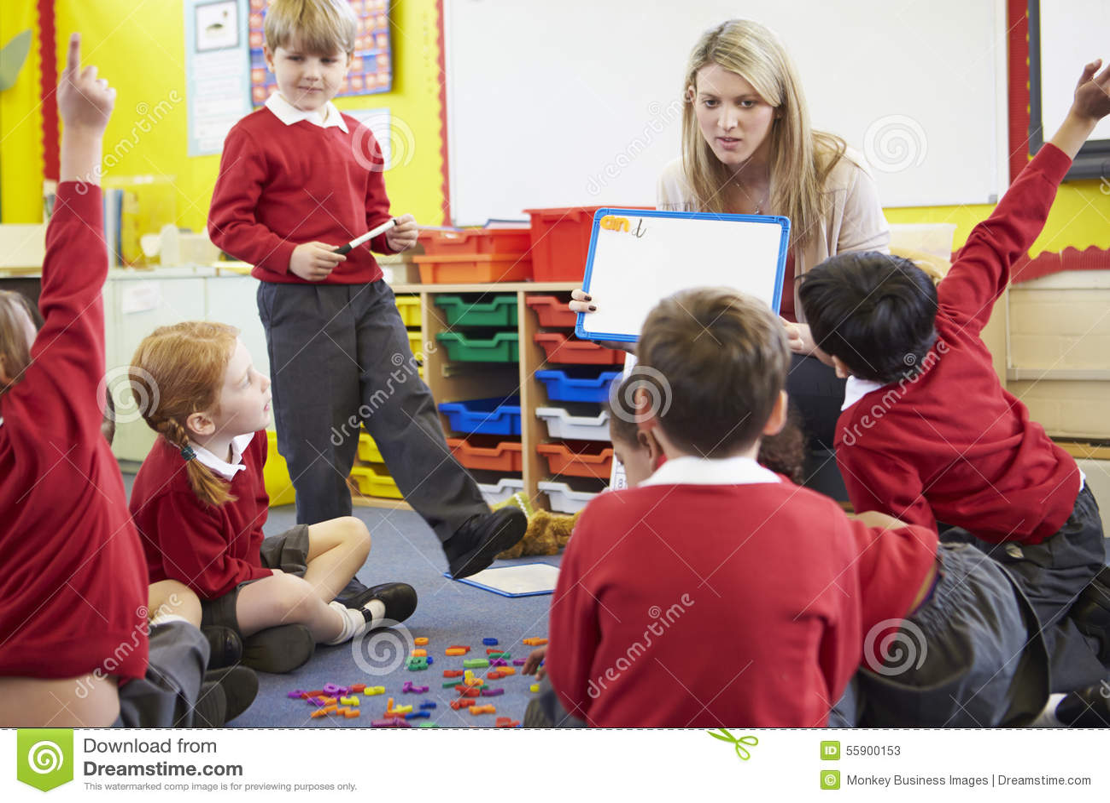 Teacher Teaching Spelling To Elementary School Pupils Stock Photo ...