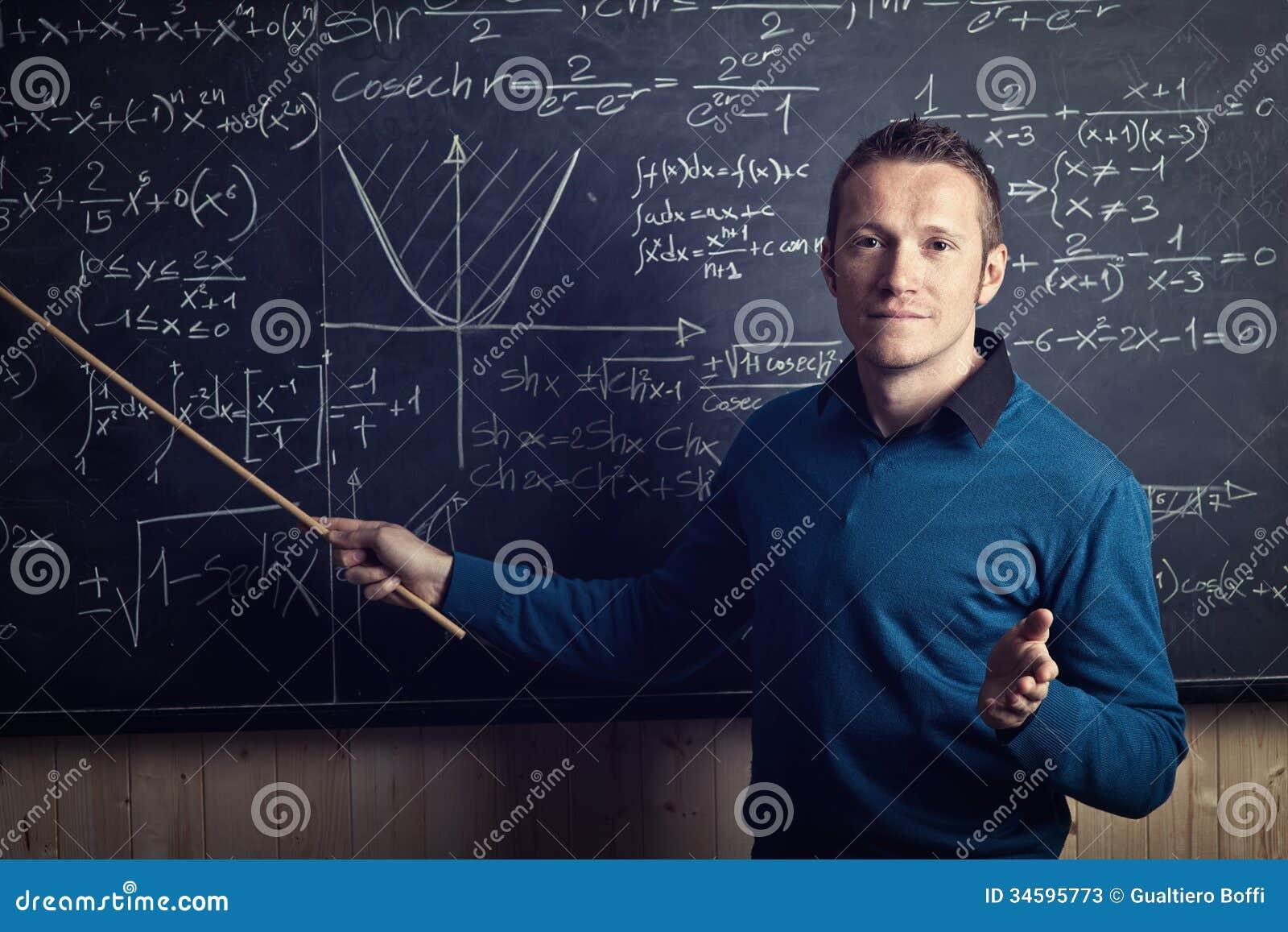 Teacher at work stock image. Image of math, chalkboard ...