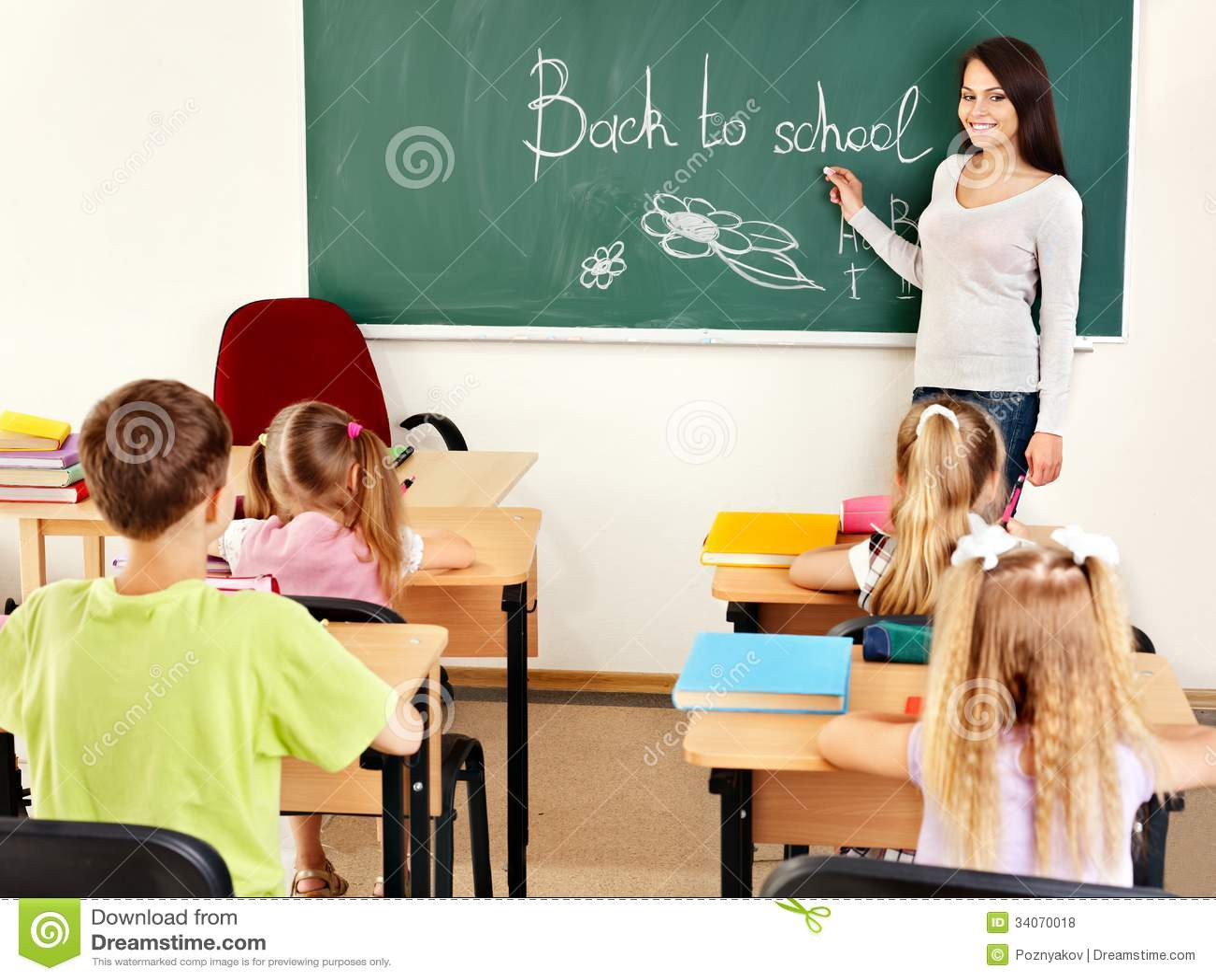 Blackboard Innovative Classroom ~ Teacher writting at blackboard in classroom stock photo