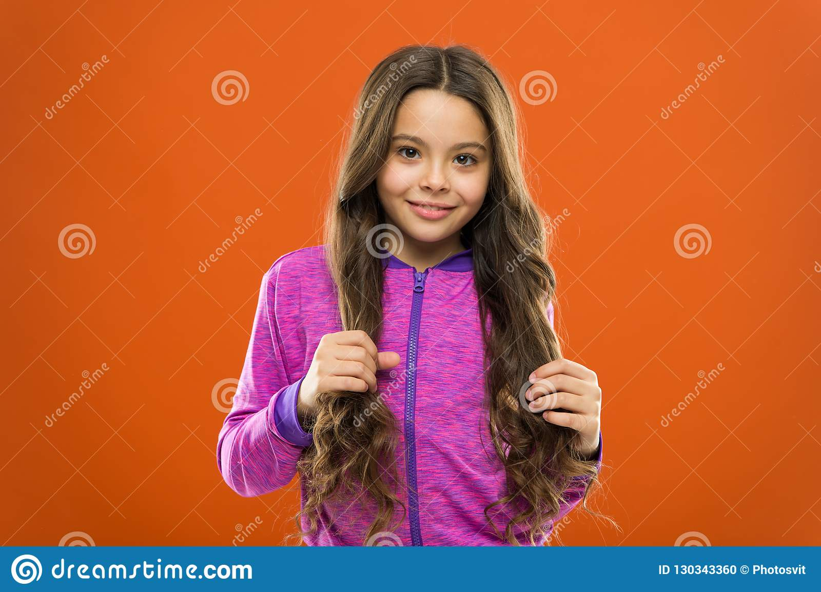 Teaching child healthy hair care habits. Strong hair concept. Kid girl long healthy shiny hair. Main thing is keeping it