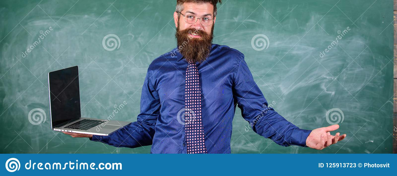 Teaching issues using modern technologies. Hipster teacher confused expression holds laptop. Distance education issues
