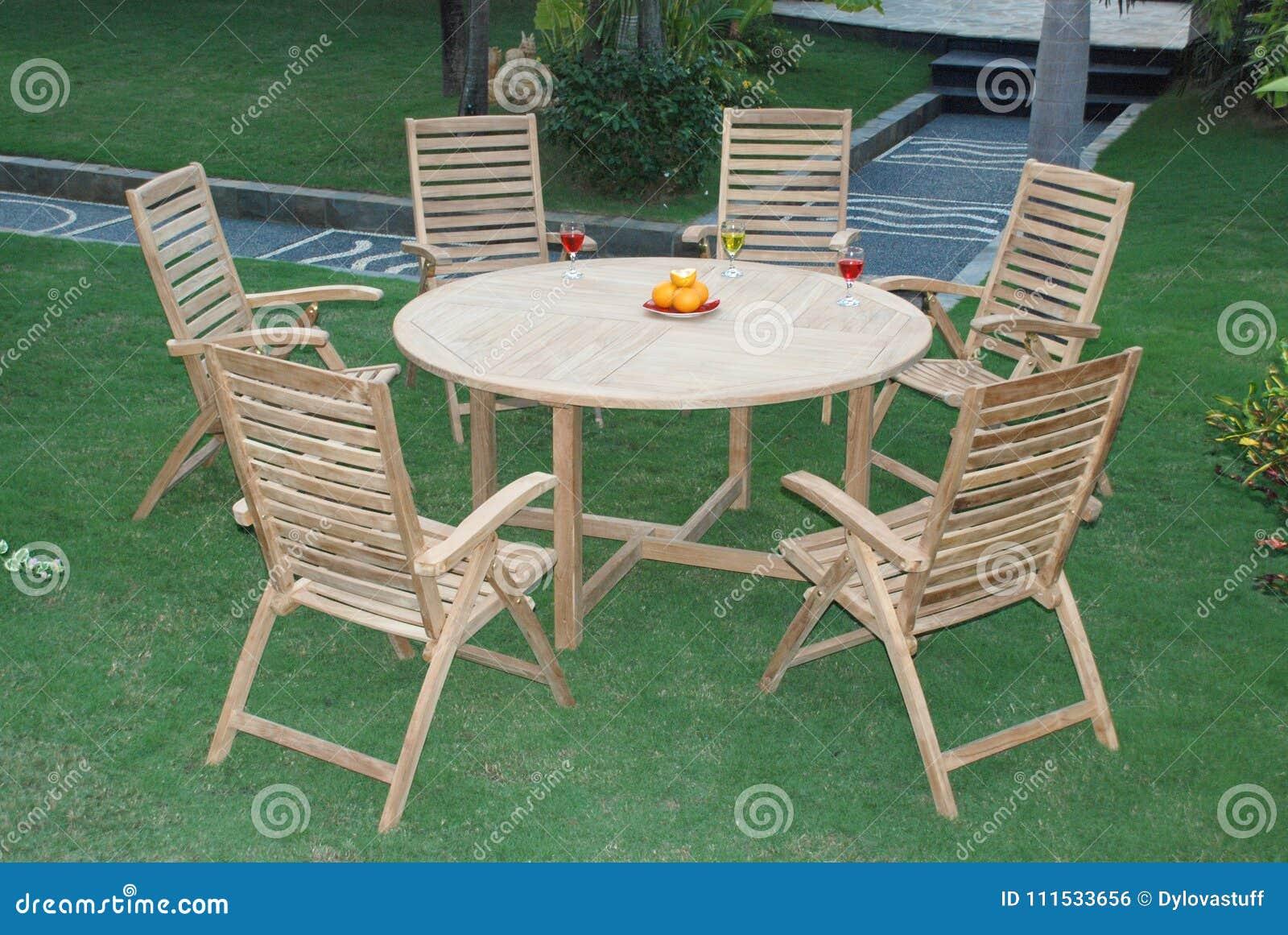 Magnificent Teak Garden Furniture Out Door Teak Garden Stock Photo Machost Co Dining Chair Design Ideas Machostcouk
