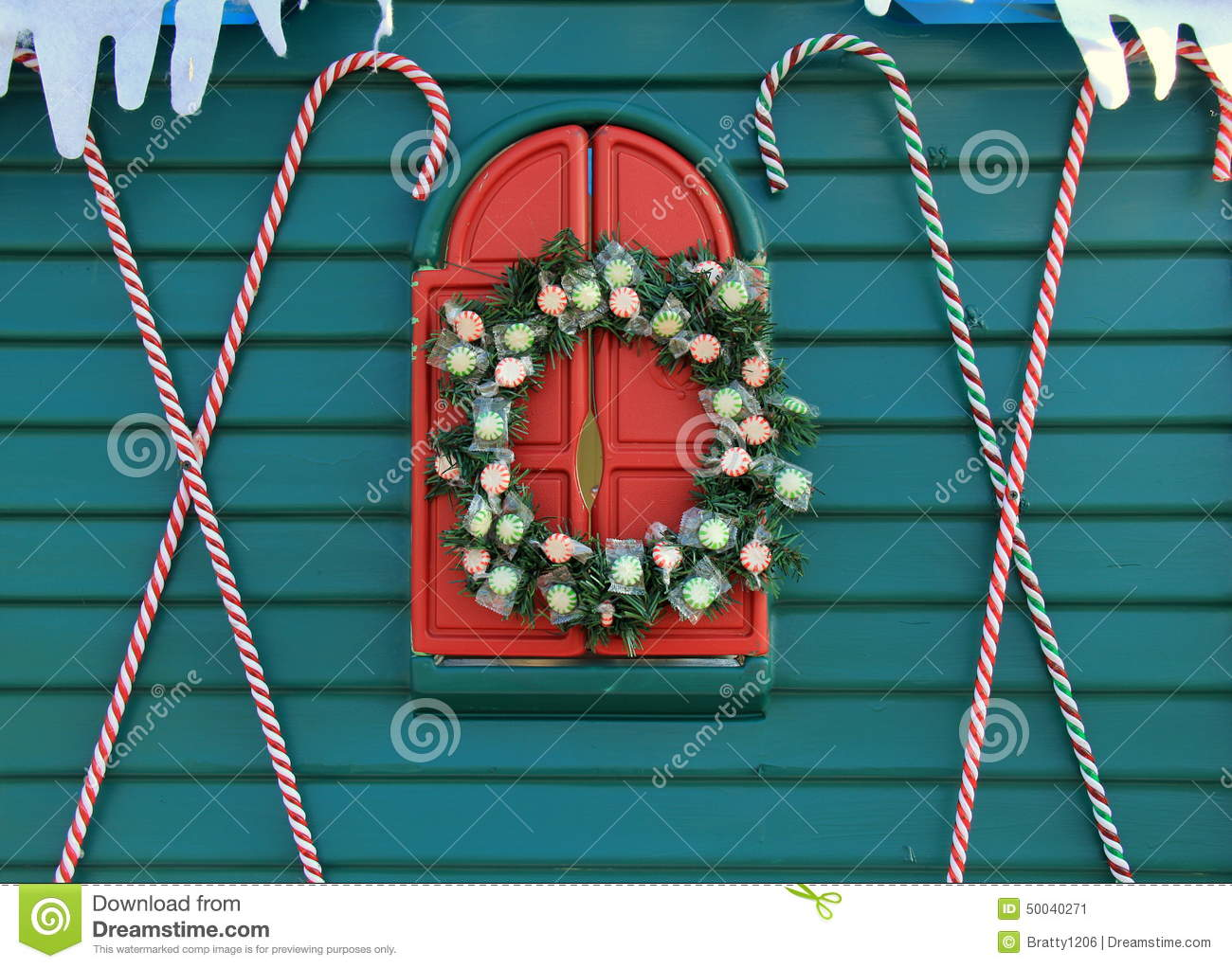 Teal Blue Wall With Candy Canes And Holiday Wreath Stock Image Image Of Decorative Icicles 50040271