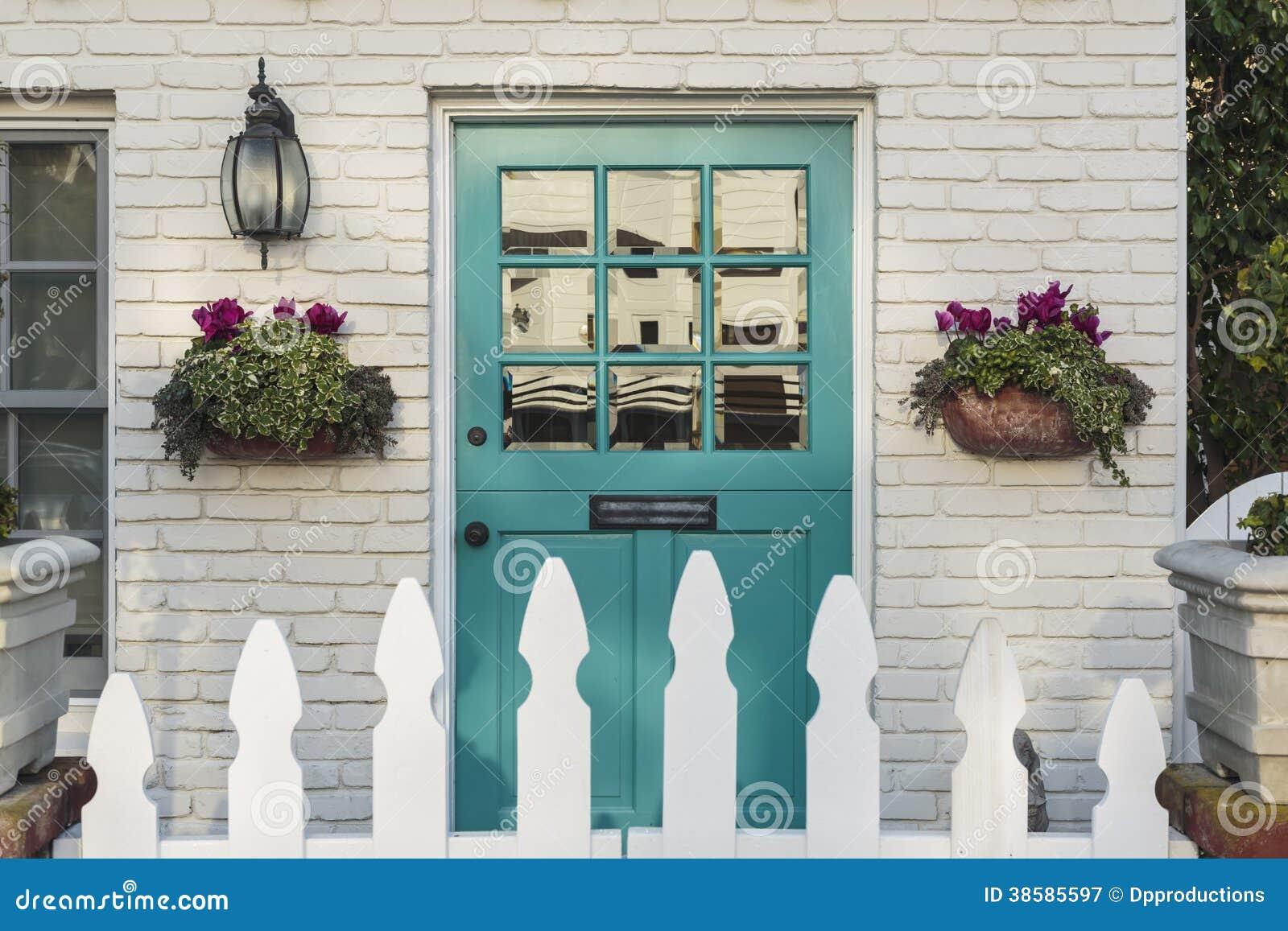 Teal front door of a classic home