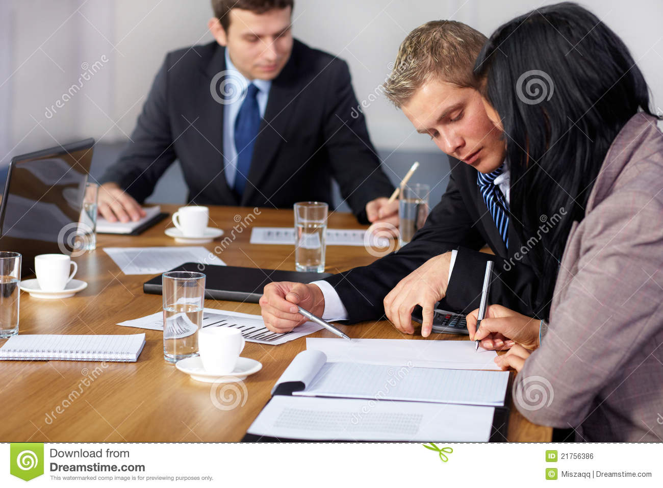 Team of 3 business people working on calculations